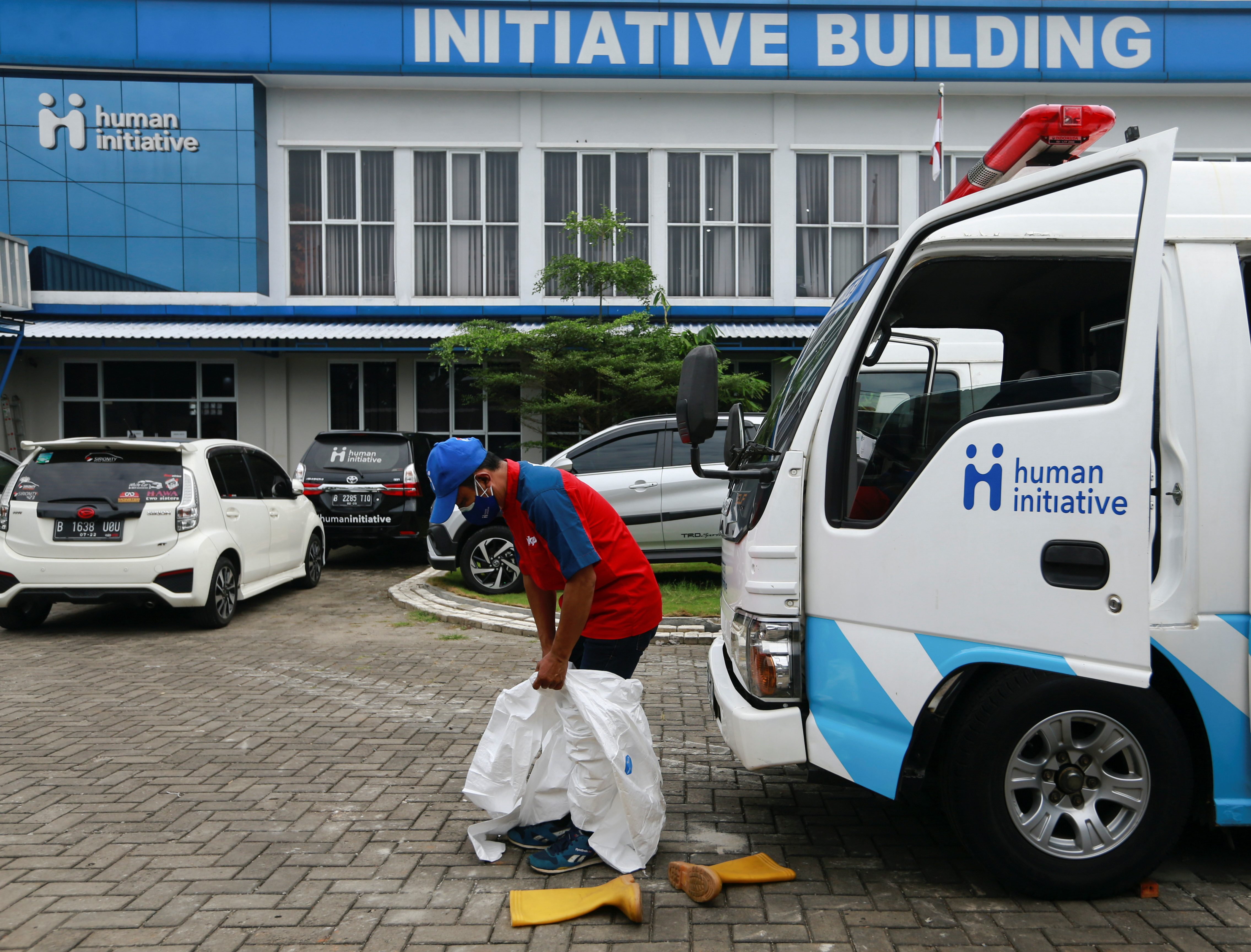 Ambulance driver Sunaryo, 53, gets ready outside the Human Initiative office to pick up a patient suffering from the coronavirus disease (COVID-19), as cases surge in Depok, on the outskirts of Jakarta, Indonesia, July 13, 2021. REUTERS/Ajeng Dinar Ulfiana