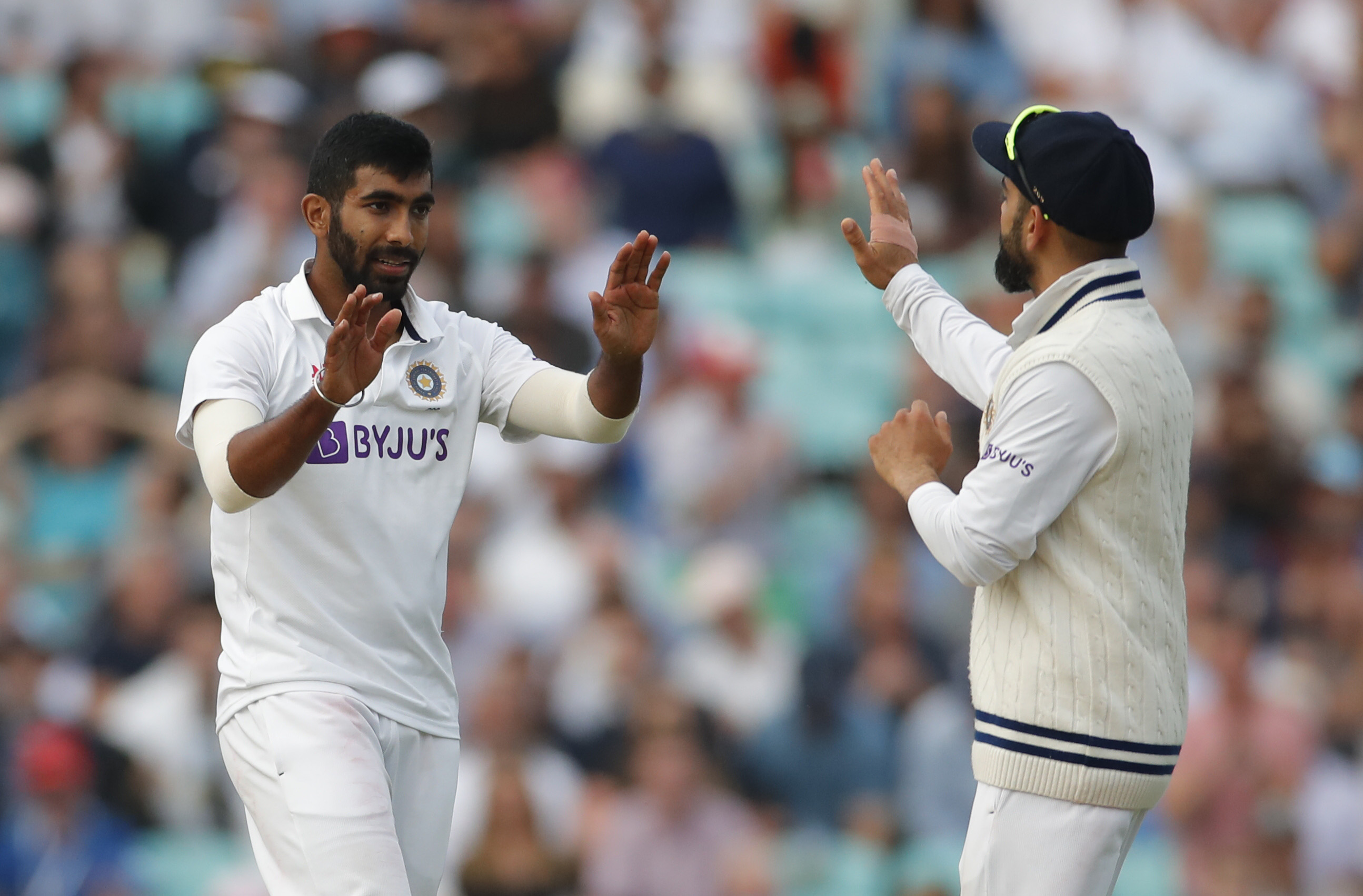 Cricket - Fourth Test - England v India - The Oval, London, Britain - September 3, 2021  India's Jasprit Bumrah celebrates with Virat Kohli after England's Chris Woakes loses his wicket Action Images via Reuters/Andrew Couldridge