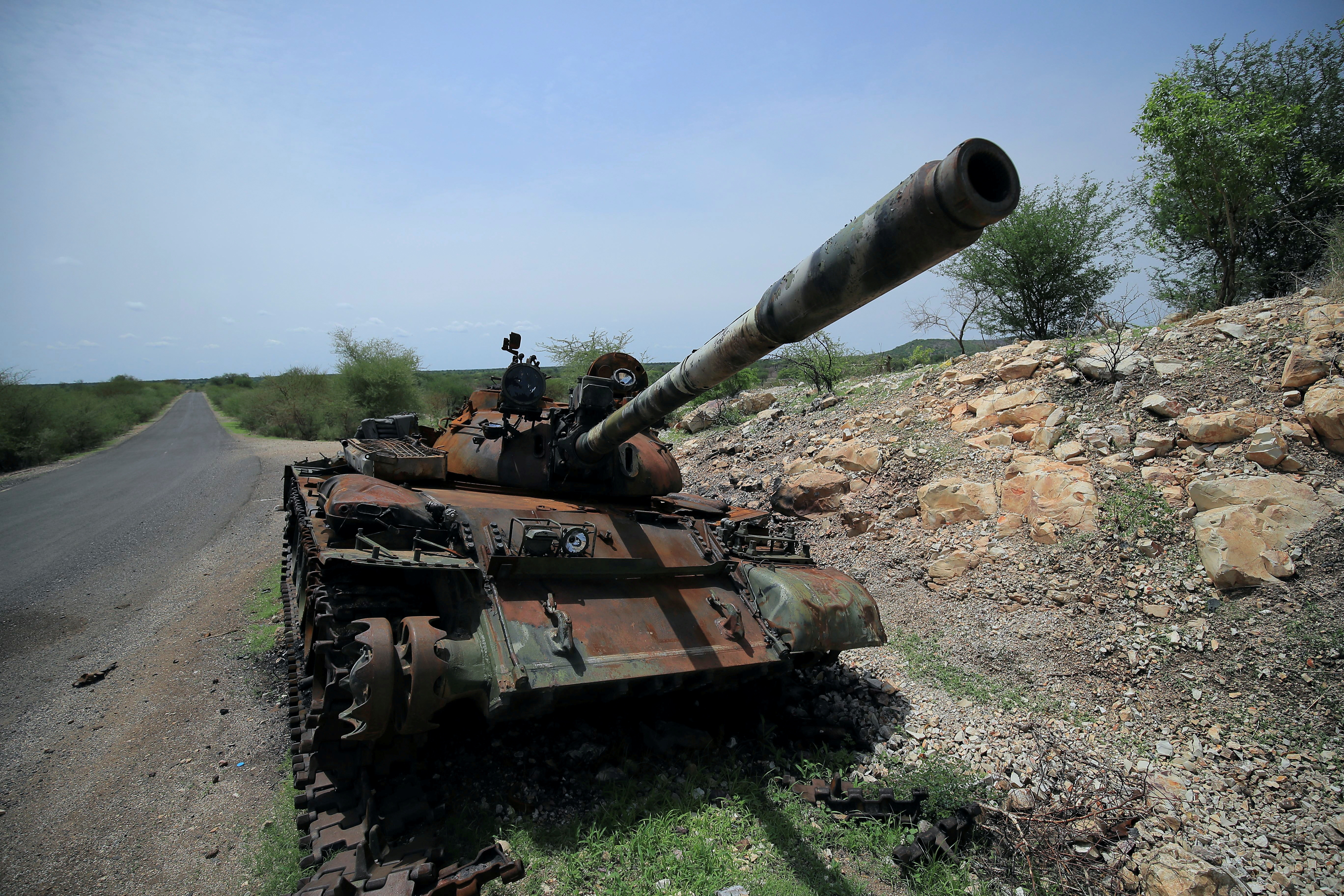 A tank damaged during the fighting between Ethiopia's National Defense Force (ENDF) and Tigray Special Forces stands on the outskirts of Humera town in Ethiopia July 1, 2021.  REUTERS/Stringer/File Photo