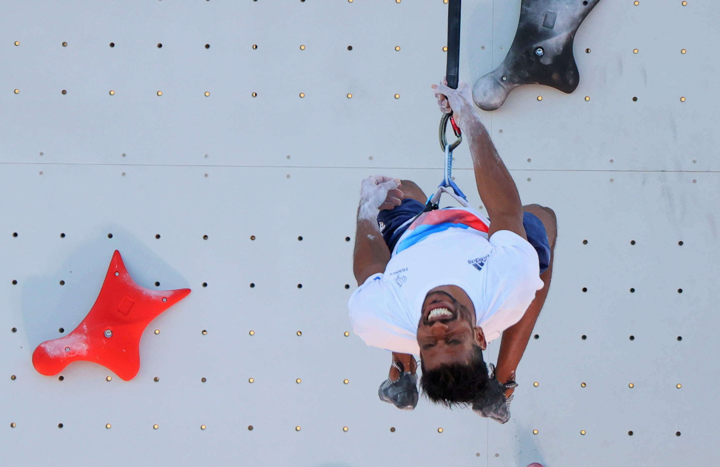 Tokyo 2020 Olympics - Sport Climbing - Men's Combined - Qualification - Aomi Urban Sports Park - Tokyo, Japan - August 3, 2021. Bassa Mawem of France reacts after competing REUTERS/Maxim Shemetov