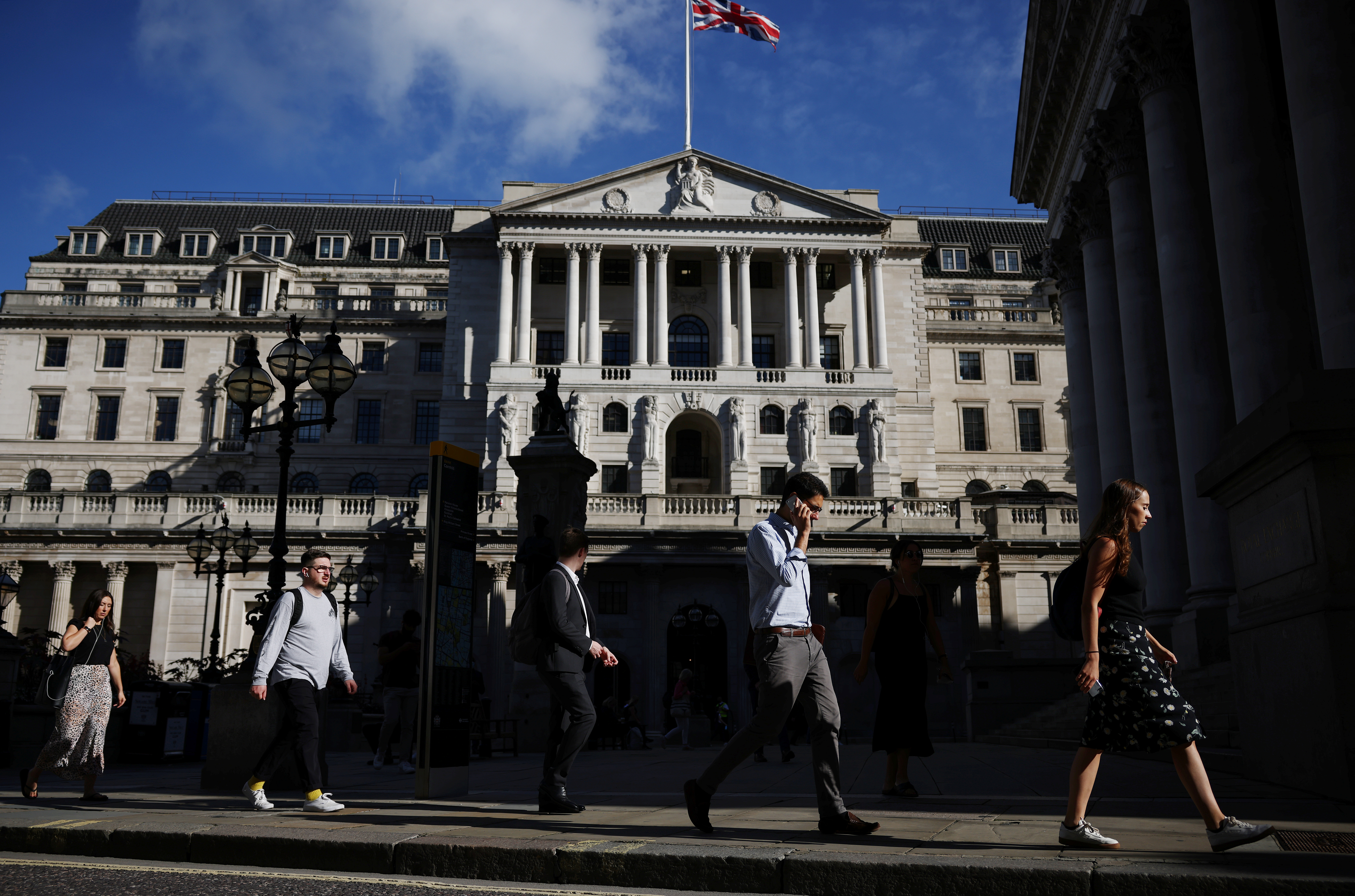People walk past the Bank of England during morning rush hour, amid the coronavirus disease (COVID-19) pandemic in London, Britain, July 29, 2021. REUTERS/Henry Nicholls