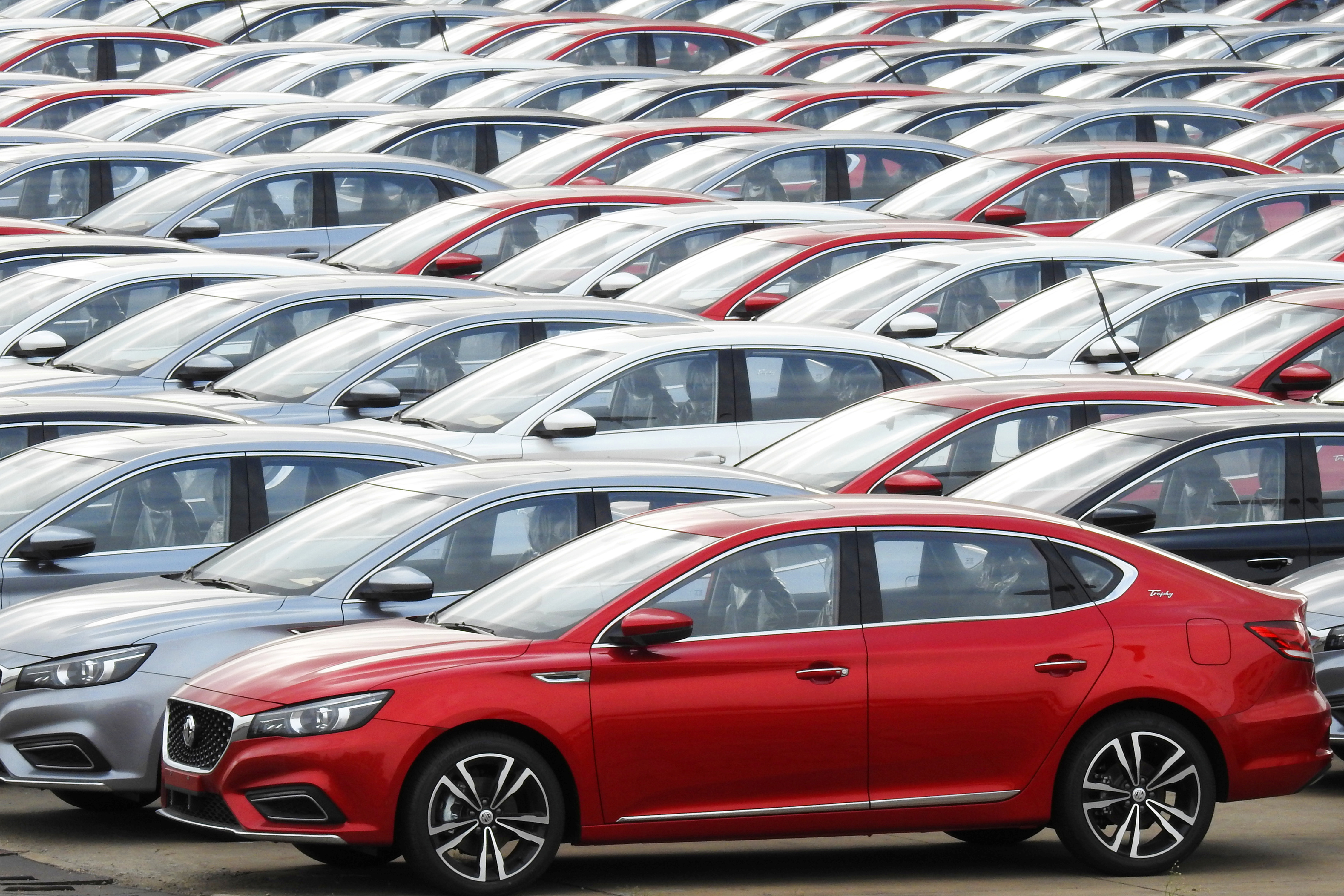 Cars for export wait to be loaded onto cargo vessels at a port in Lianyungang, Jiangsu province, China October 14, 2019. REUTERS/Stringer