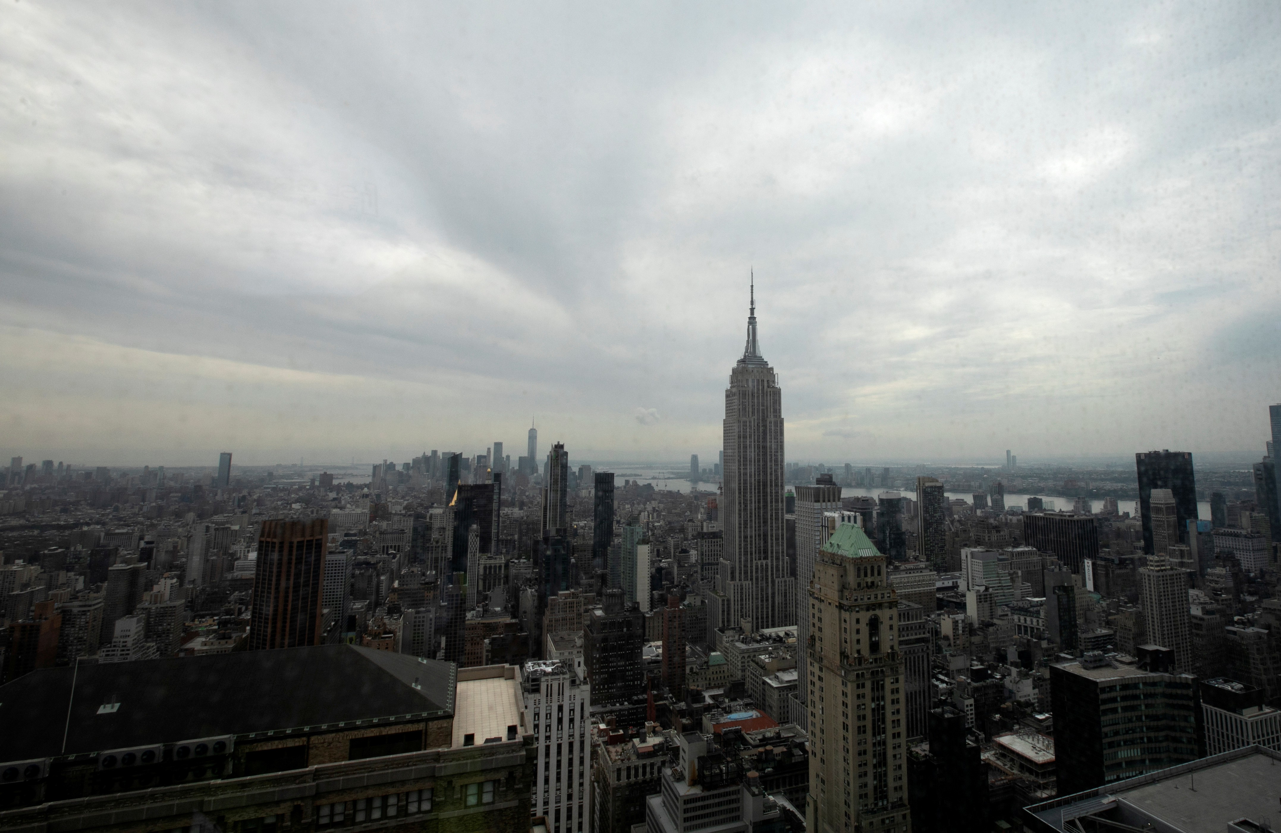 The Empire State Building and Manhattan skyline is seen from the 77 story One Vanderbilt office tower, th. Picture taken September 9, 2020. REUTERS/Mike Segar
