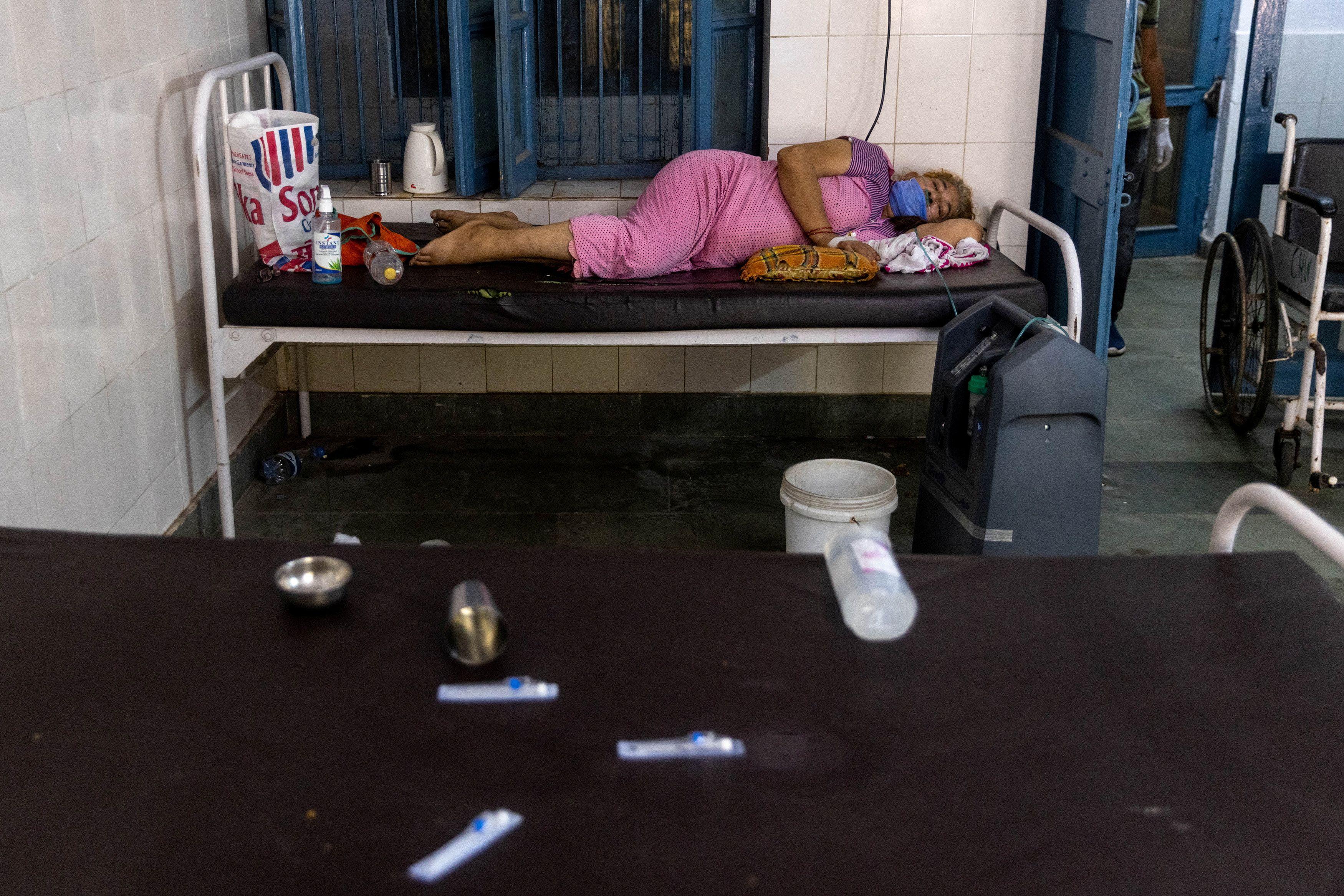 A woman receives treatment inside a COVID-19 ward of a government-run hospital, amidst the coronavirus disease (COVID-19) pandemic, in Bijnor district, Uttar Pradesh, India, May 11, 2021. REUTERS/Danish Siddiqui