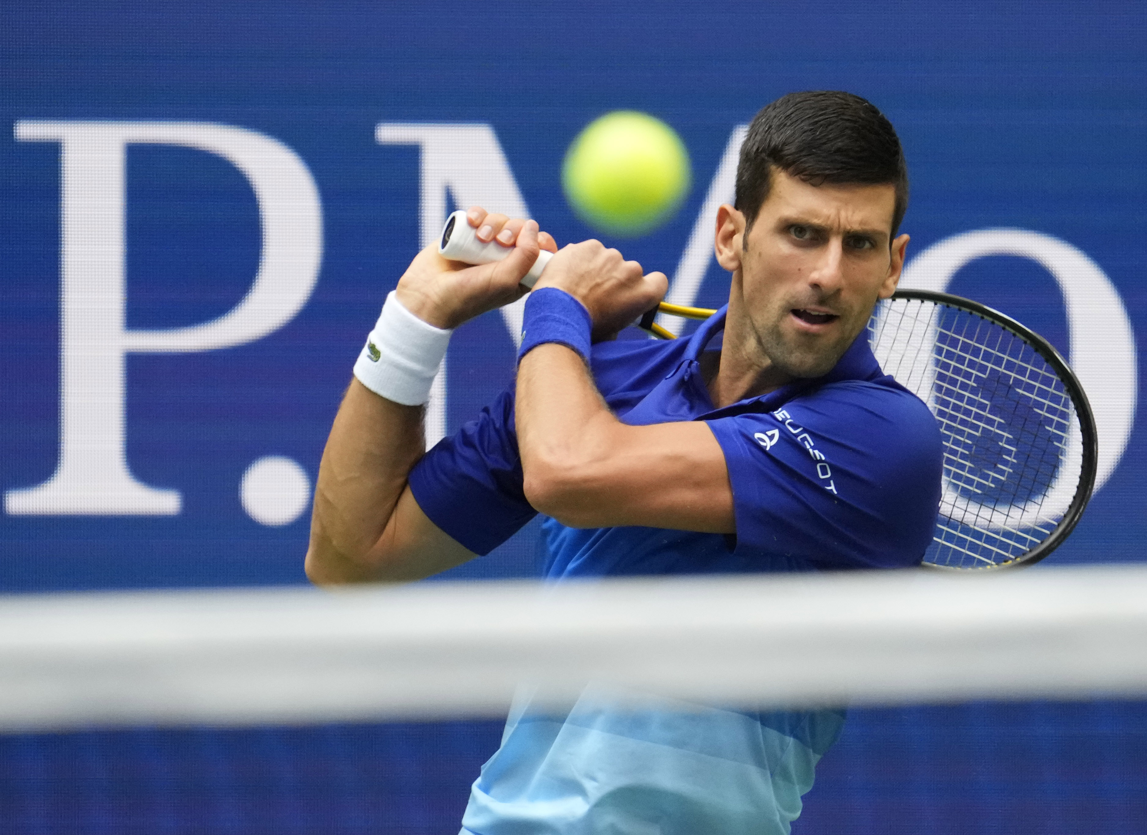 Sep 12, 2021; Flushing, NY, USA; Novak Djokovic of Serbia hits to Daniil Medvedev of Russia in the men's singles final on day fourteen of the 2021 U.S. Open tennis tournament at USTA Billie Jean King National Tennis Center. Mandatory Credit: Robert Deutsch-USA TODAY Sports/File photo