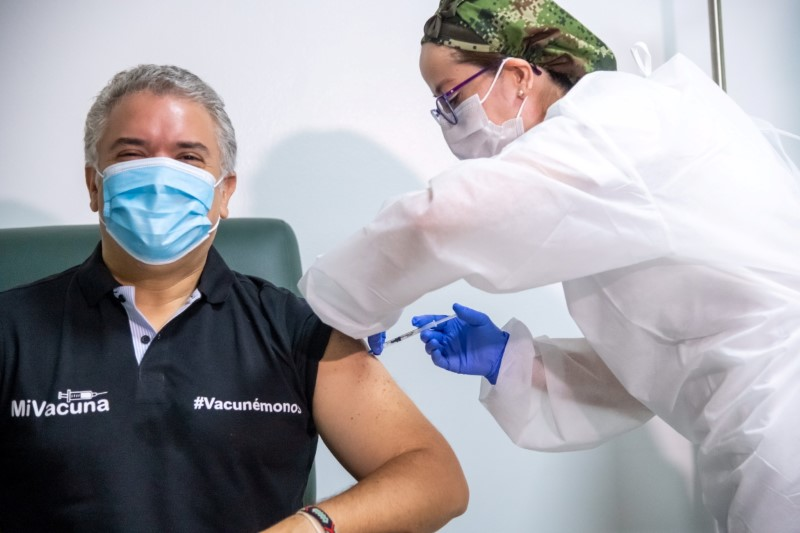 Colombia's President Ivan Duque gets his first shot of the Pfizer-BioNTech COVID-19 vaccine, in Bogota, Colombia June 13, 2021. Colombia Presidency/Handout via REUTERS