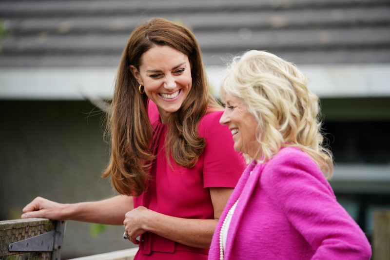 U.S. first lady Jill Biden and Britain's Catherine, Duchess of Cambridge, react during a visit to Connor Downs Academy, in Hayle, Cornwall, Britain, June 11, 2021. Aaron Chown/Pool via REUTERS