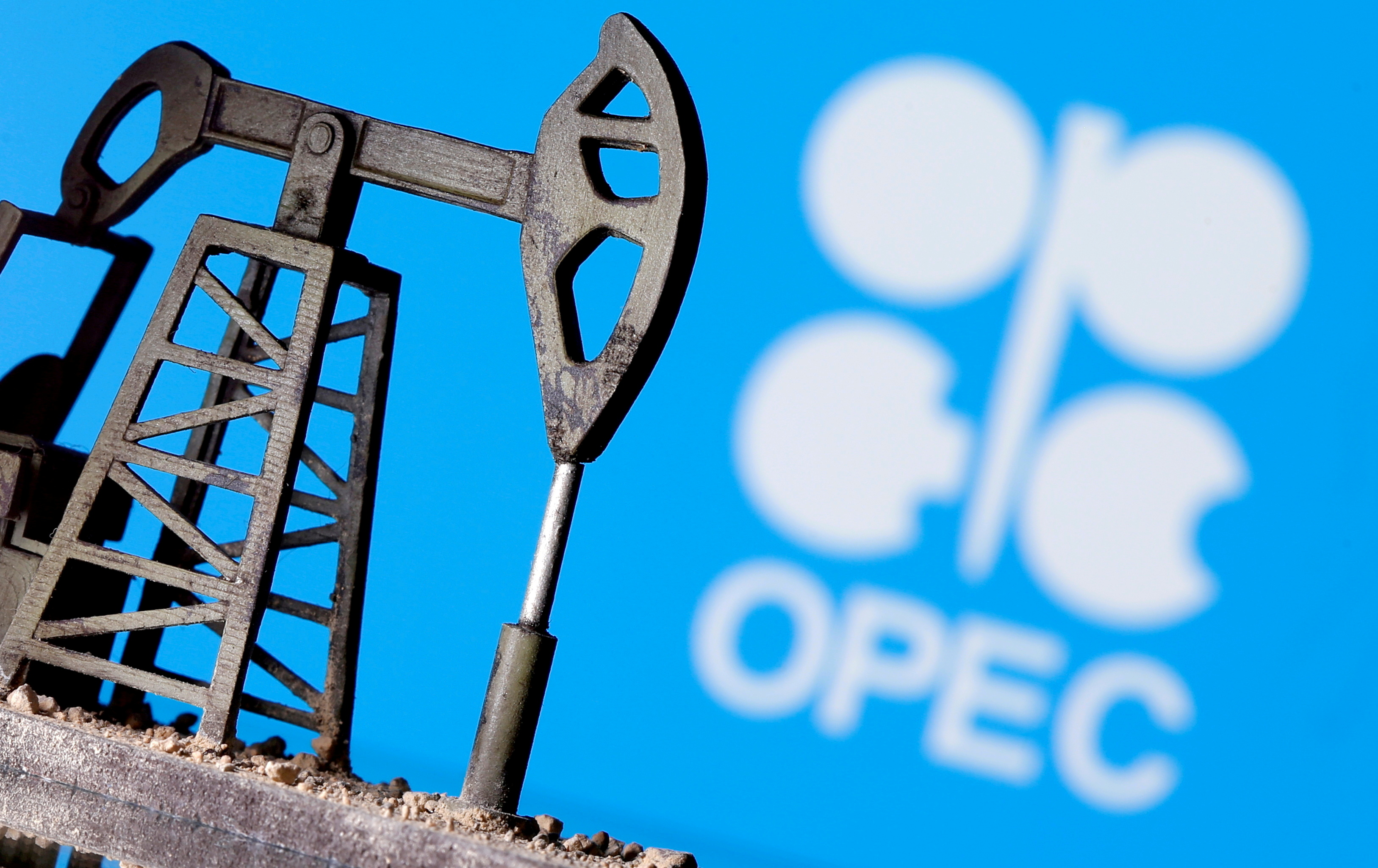 A 3D-printed oil pump jack is seen in front of a displayed OPEC logo in this illustration picture, April 14, 2020. REUTERS/Dado Ruvic