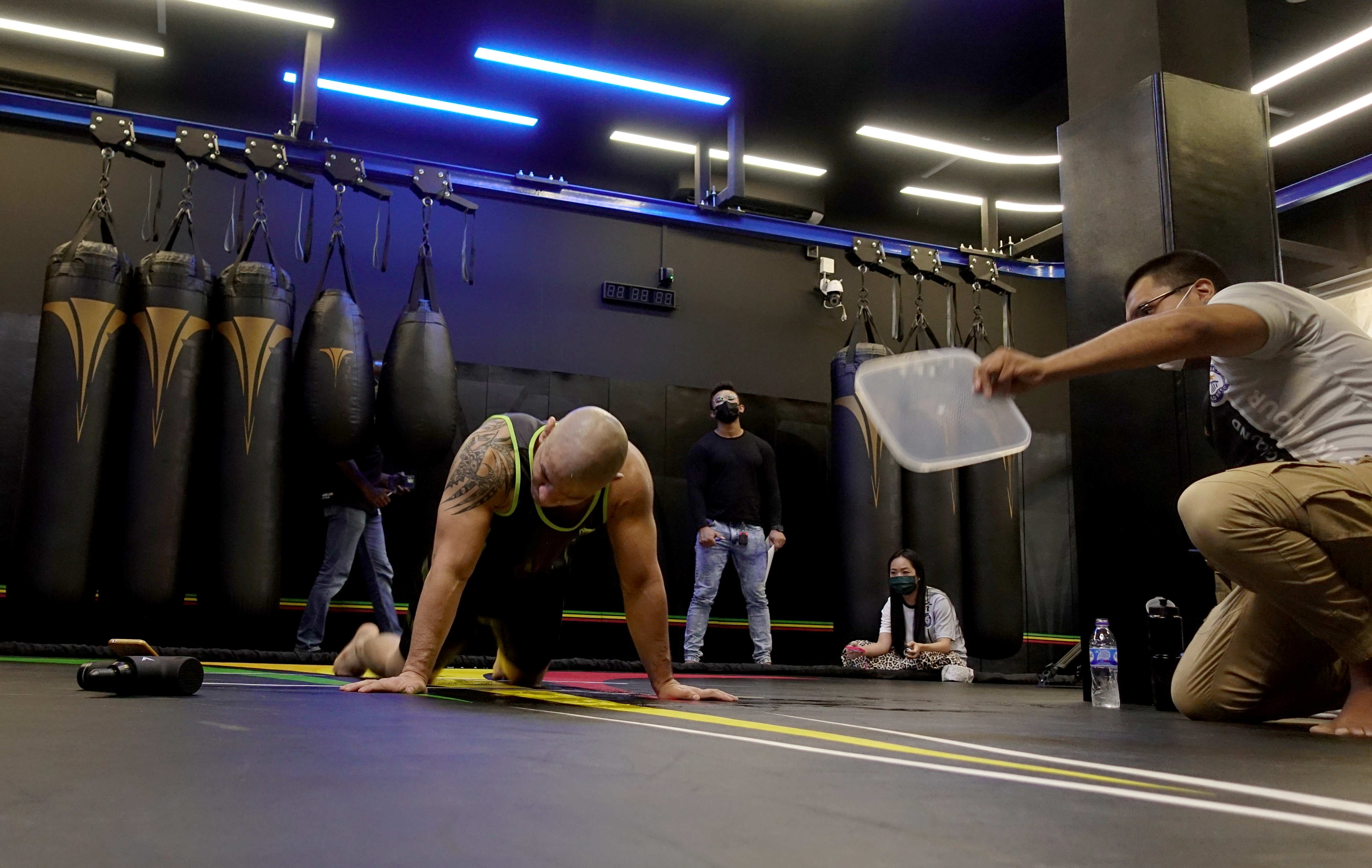 Cassiano Rodrigues Laureano breaks Guinness World Record of most number of burpees in 60 minutes, in Singapore June 25, 2021. REUTERS/Joseph Campbell