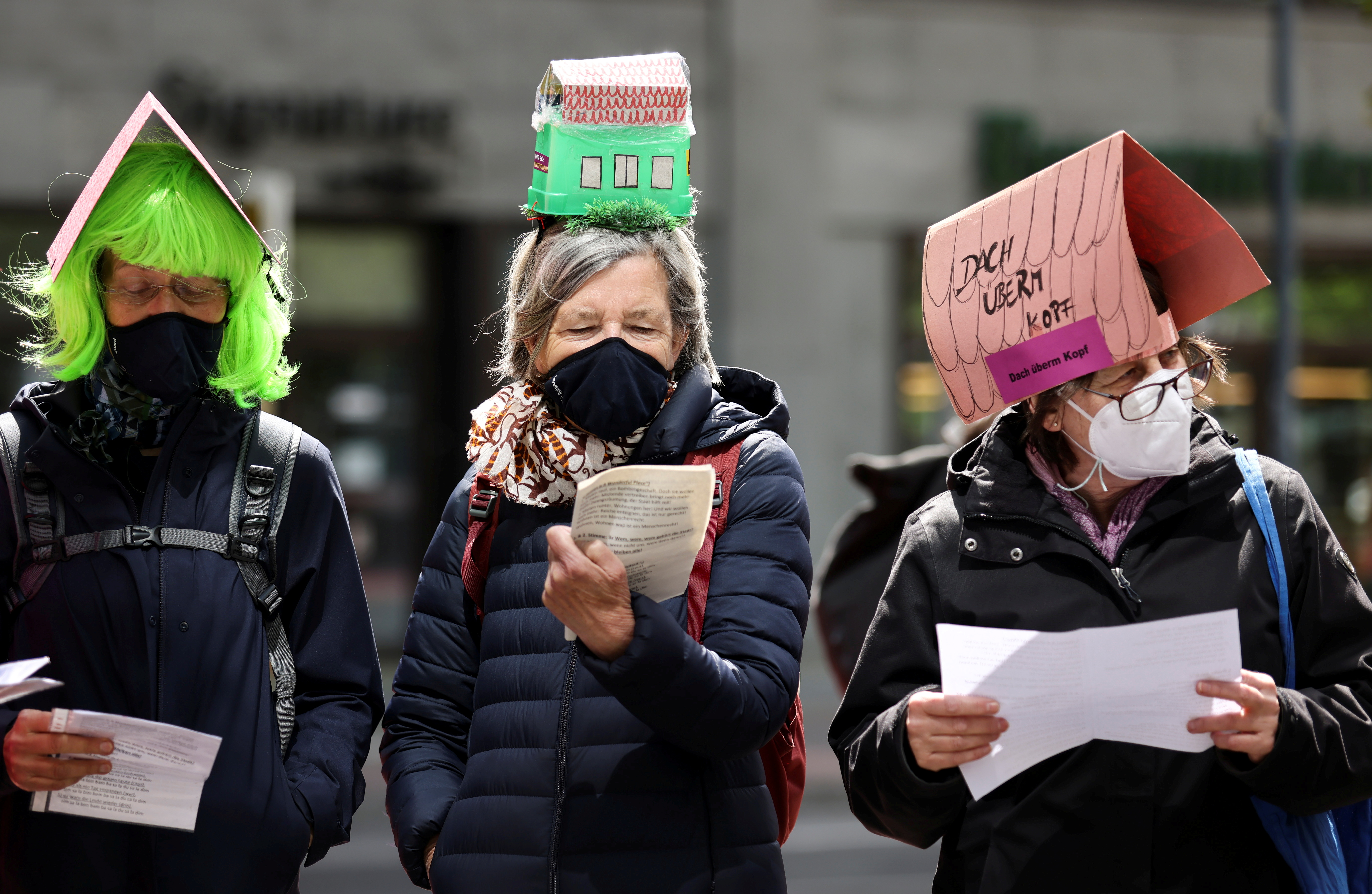 A sign on a head of a protester reads
