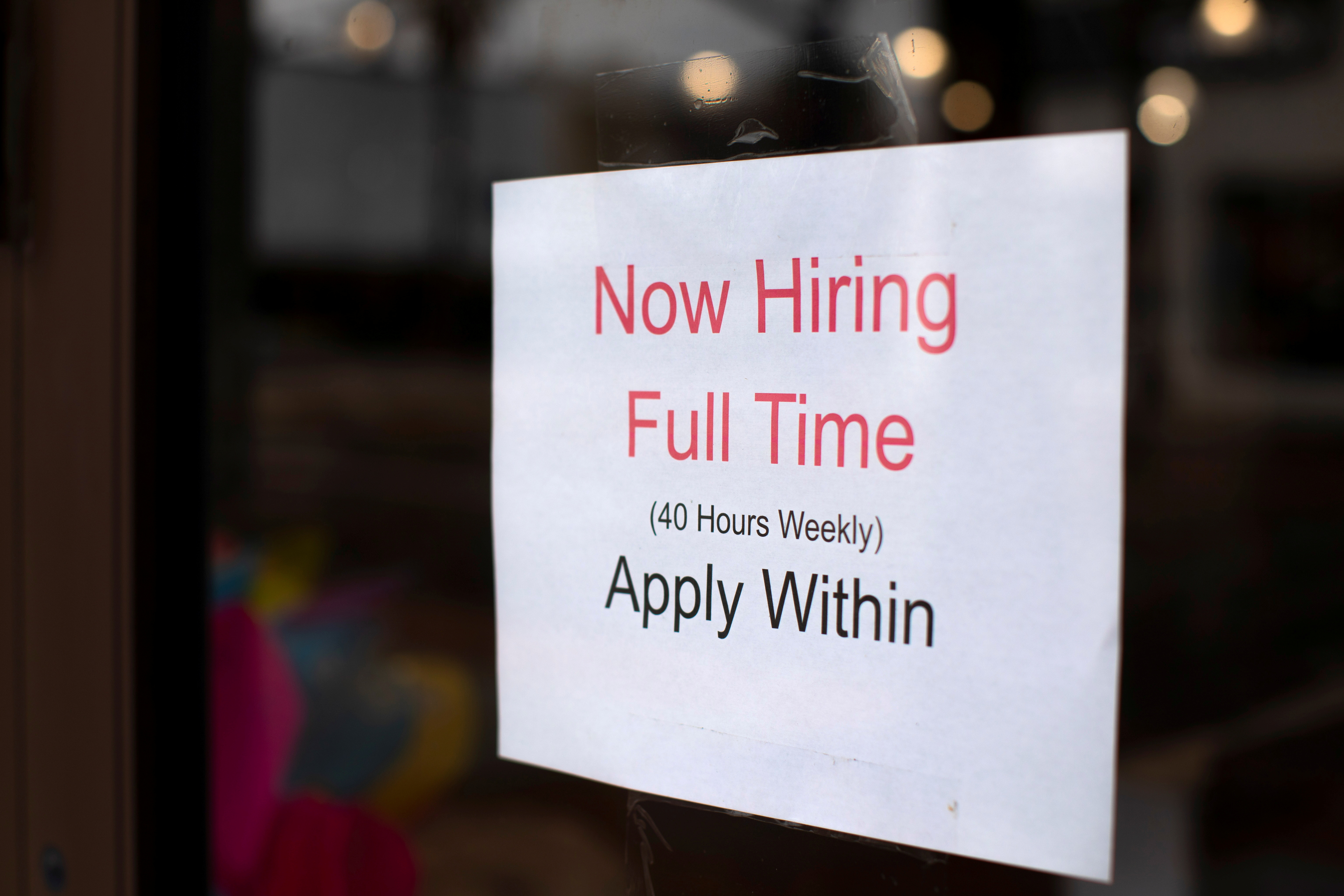 A retail store advertising a full time job on its shop window in Oceanside, California, U.S., May 10, 2021. REUTERS/Mike Blake/File Photo