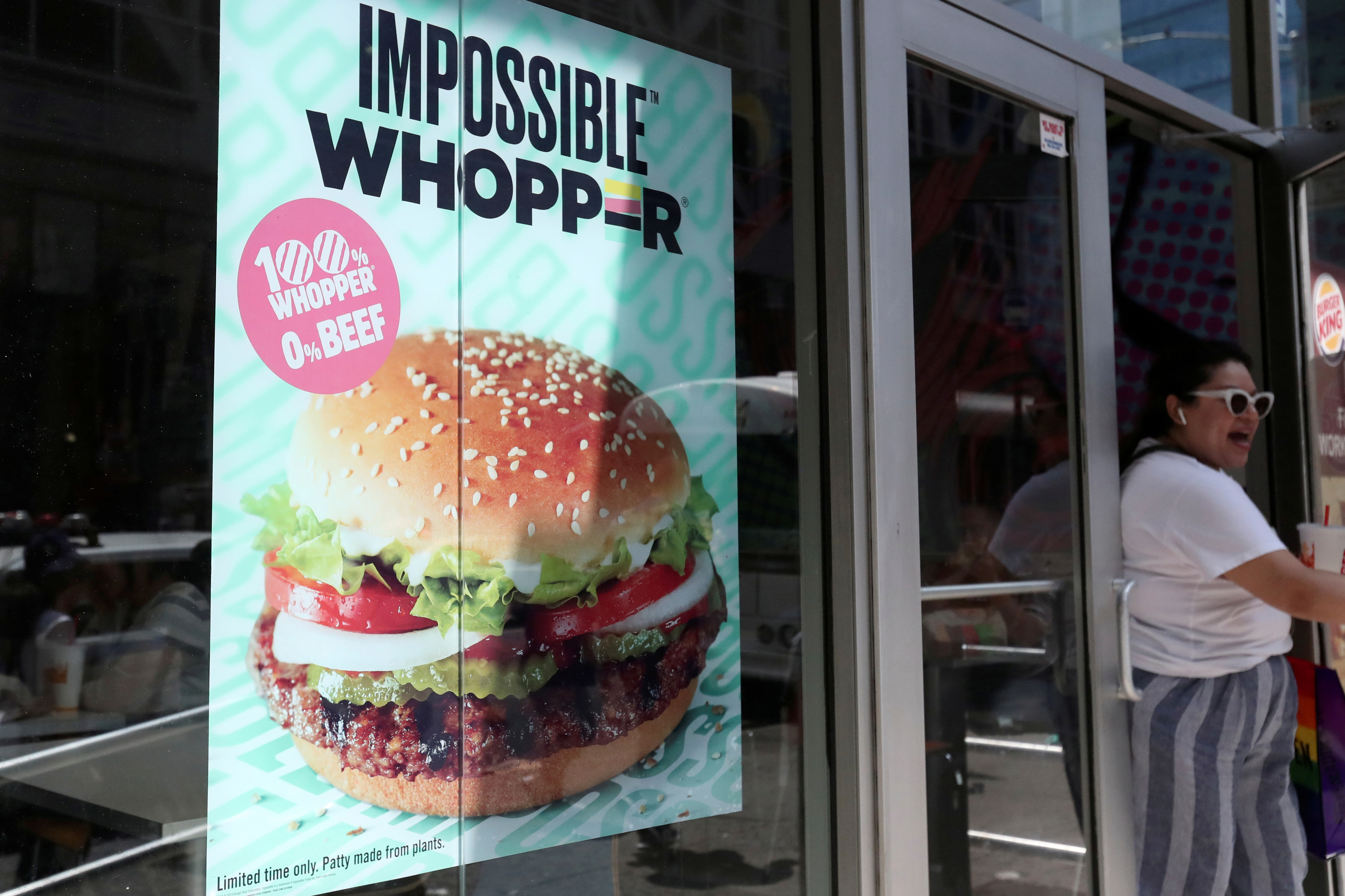 A sign advertising the soy based Impossible Whopper is seen outside a Burger King in New York, U.S., August 8, 2019. REUTERS/Shannon Stapleton/File Photo