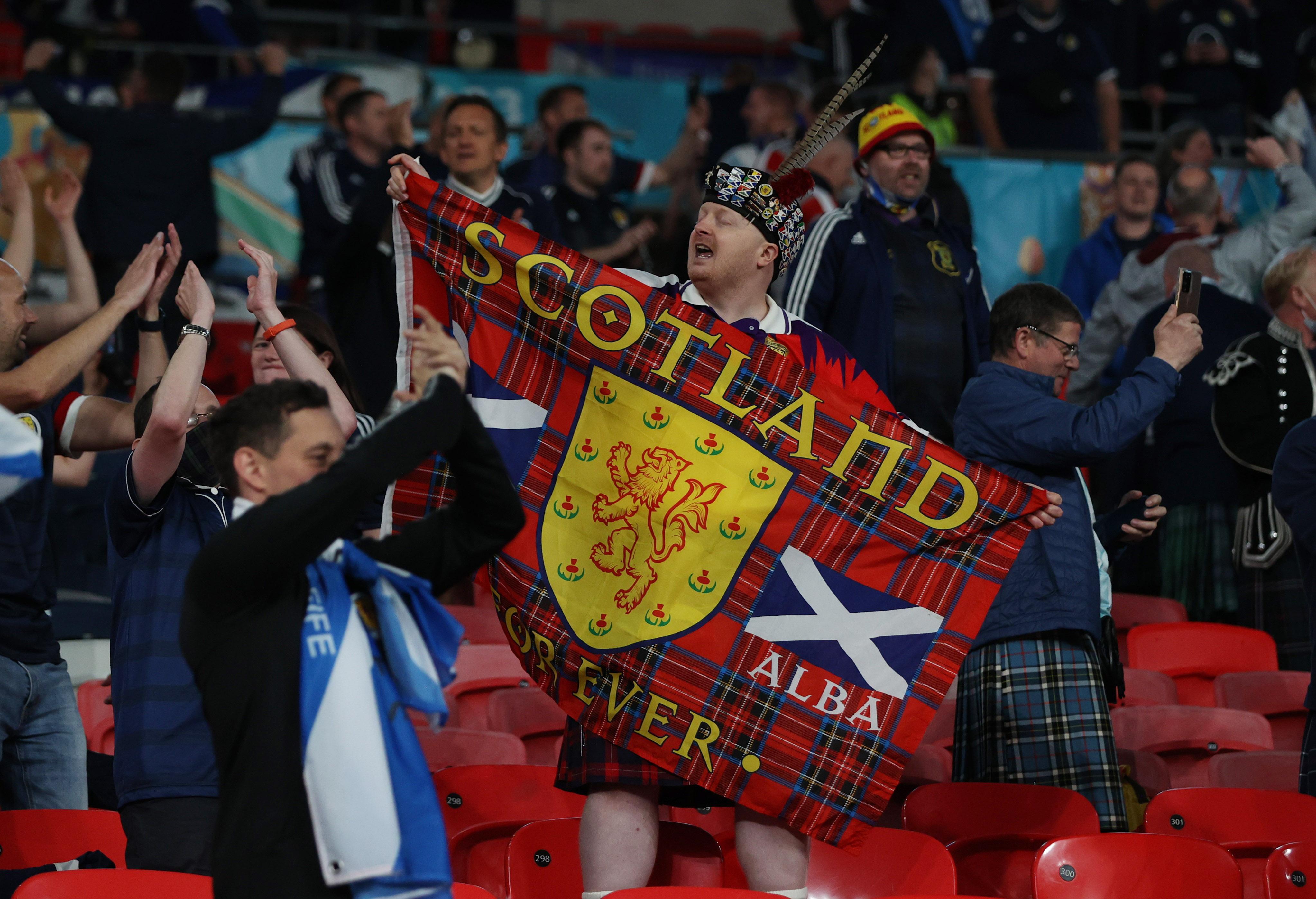 Soccer Football - Euro 2020 - Group D - England v Scotland - Wembley Stadium, London, Britain - June 18, 2021 Scotland fans celebrate after the match Pool via REUTERS/Carl Recine