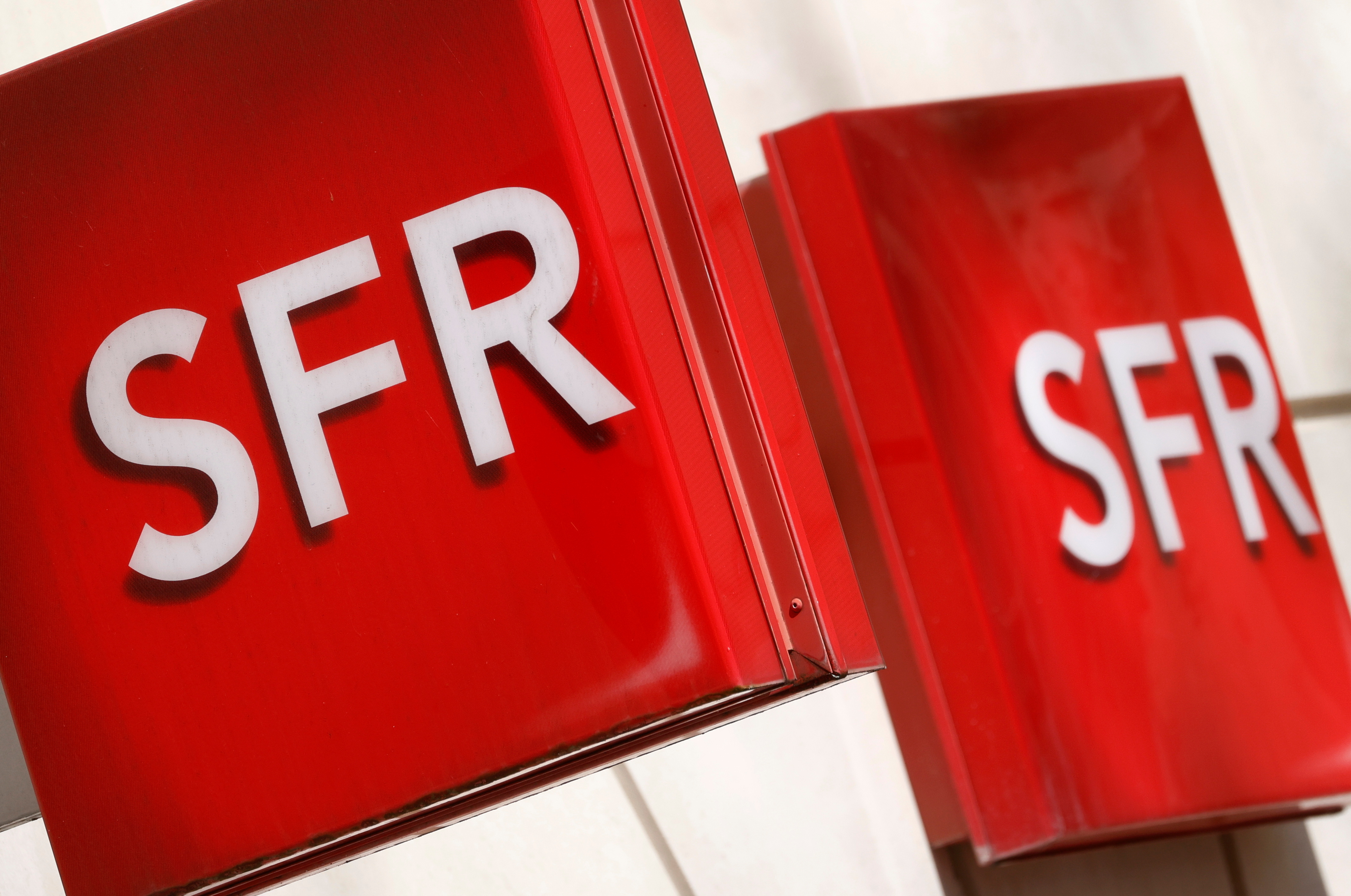 Logos of French telecoms operator SFR are pictured on a shop in Niort, France, March 4, 2021. REUTERS/Stephane Mahe