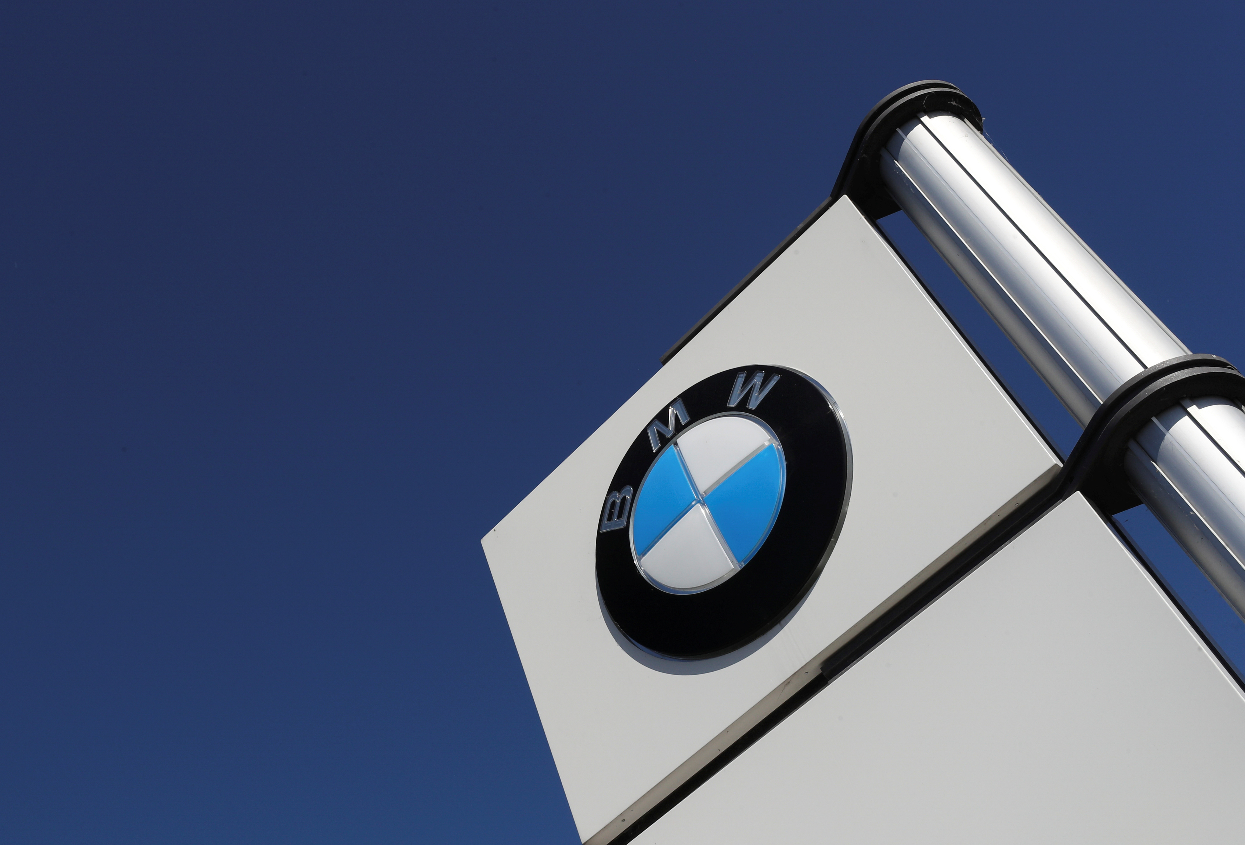 A logo of BMW is seen outside a BMW car dealer, amid the coronavirus disease (COVID-19) outbreak in Brussels, Belgium May 28, 2020. REUTERS/Yves Herman