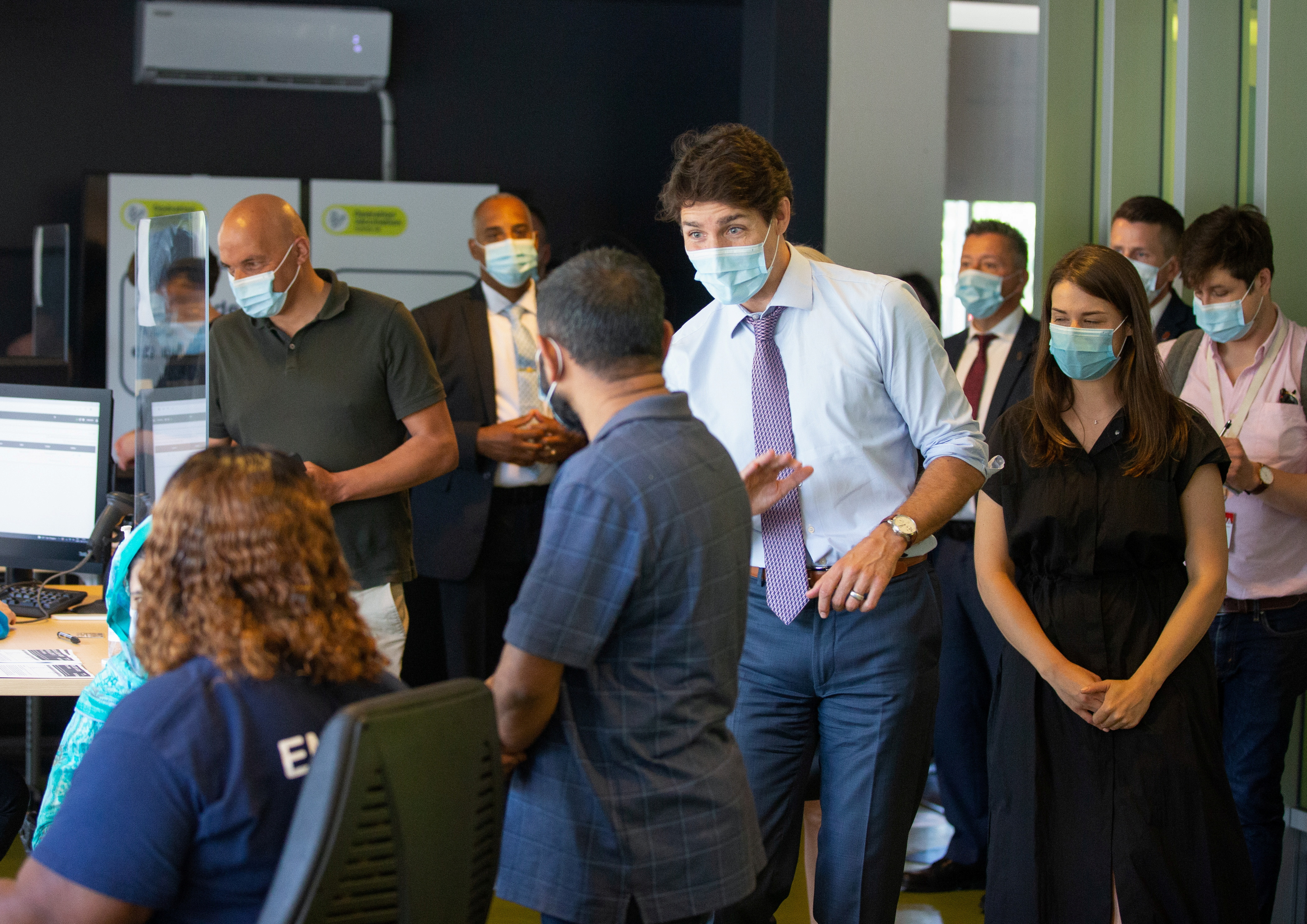 Canada's Prime Minister Justin Trudeau greets people as he visits a vaccination site, amid the coronavirus disease (COVID-19) pandemic, in Montreal, Quebec, Canada July 15, 2021. REUTERS/Christinne Muschi