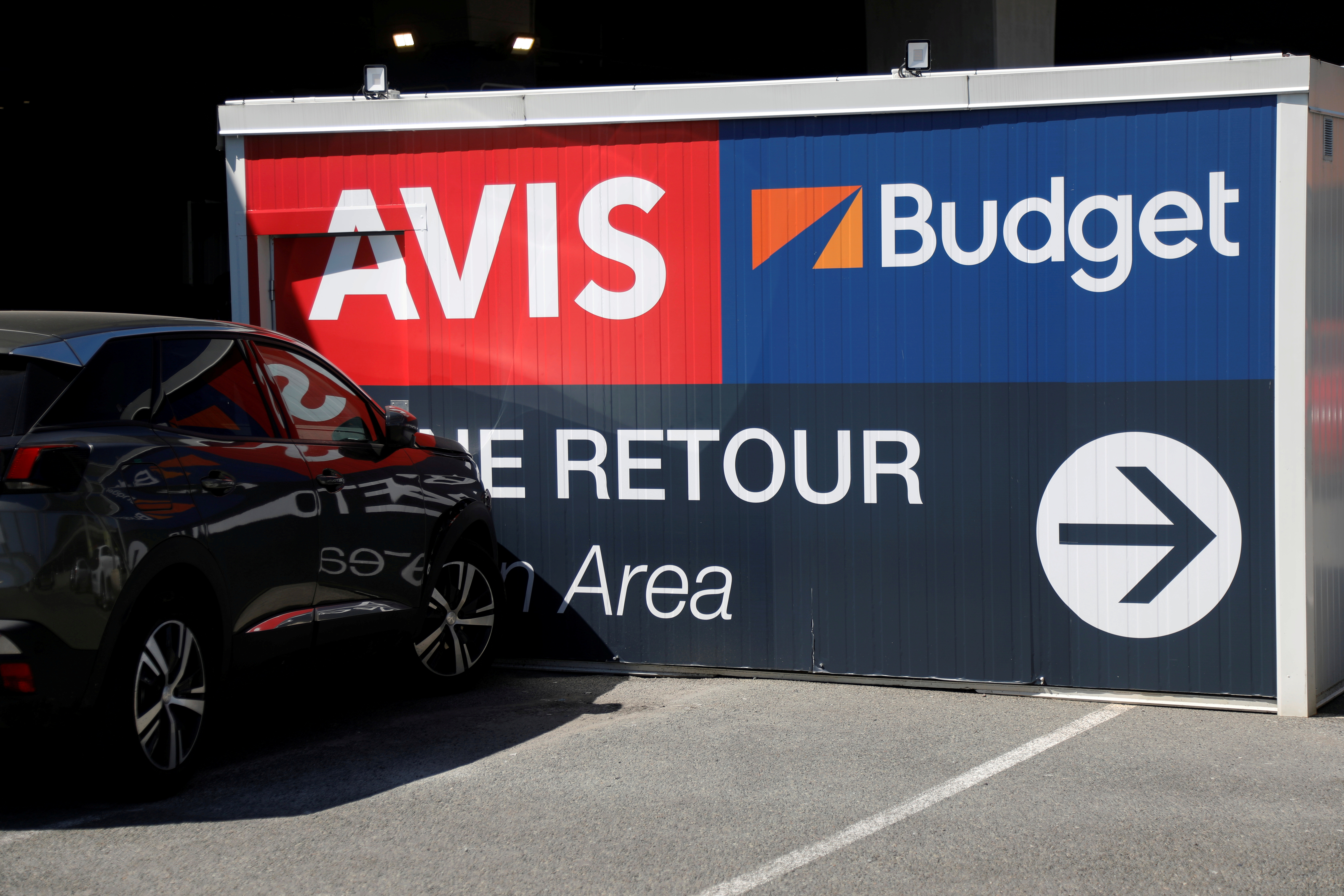 Logos of car rental companies Avis and Budget are seen outside Paris Charles de Gaulle airport in Roissy-en-France during the outbreak of the coronavirus disease (COVID-19) in France May 19, 2020.  REUTERS/Charles Platiau