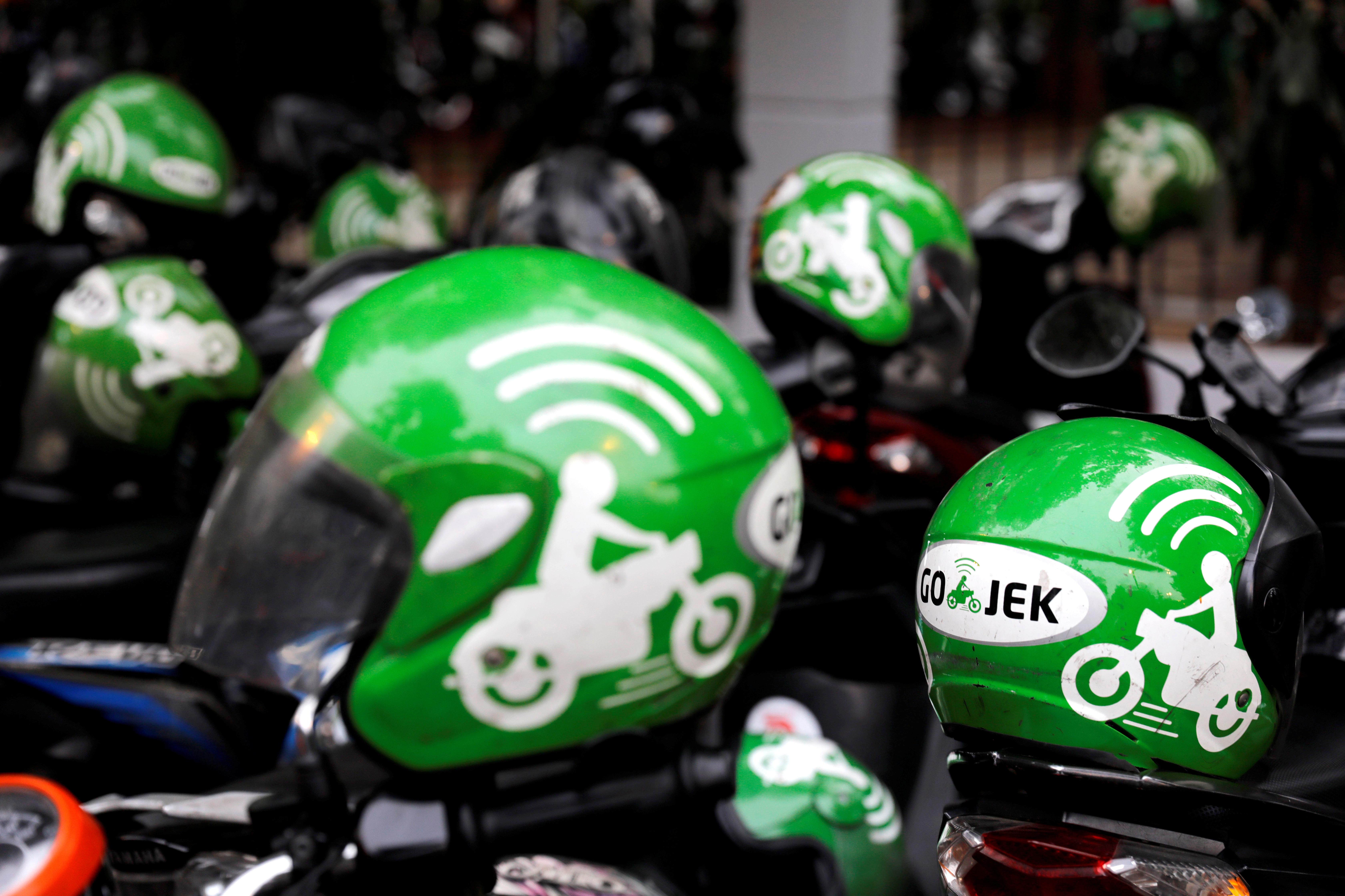 FILE PHOTO: Gojek driver helmets are seen during Go-Food festival in Jakarta, Indonesia, October 27, 2018. REUTERS/Beawiharta