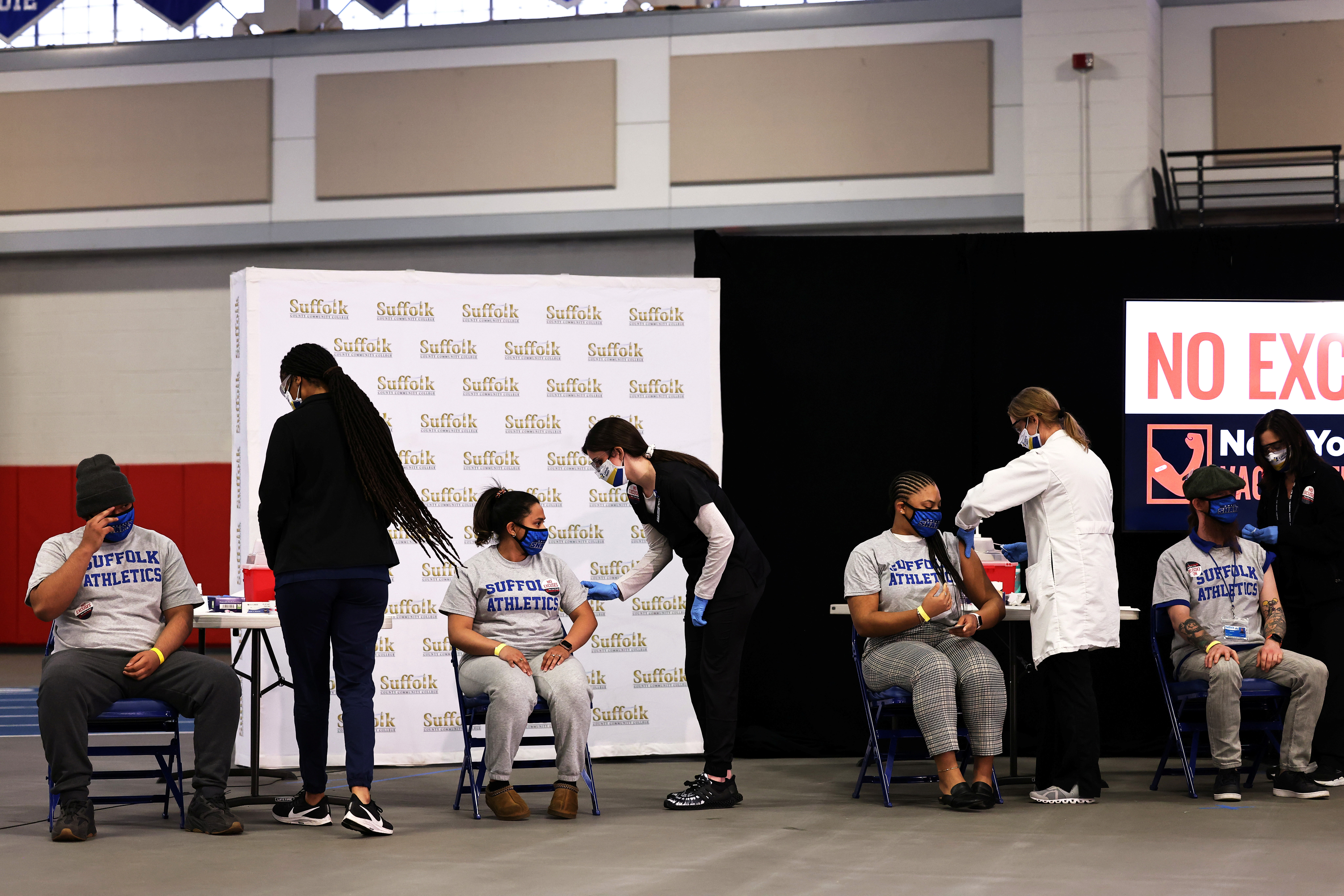 Students from Suffolk County Community College prepare to get vaccinated during a news conference on COVID-19 vaccination at Suffolk County Community College in Brentwood, New York, U.S. April 12, 2021. Michael M. Santiago/Pool via REUTERS