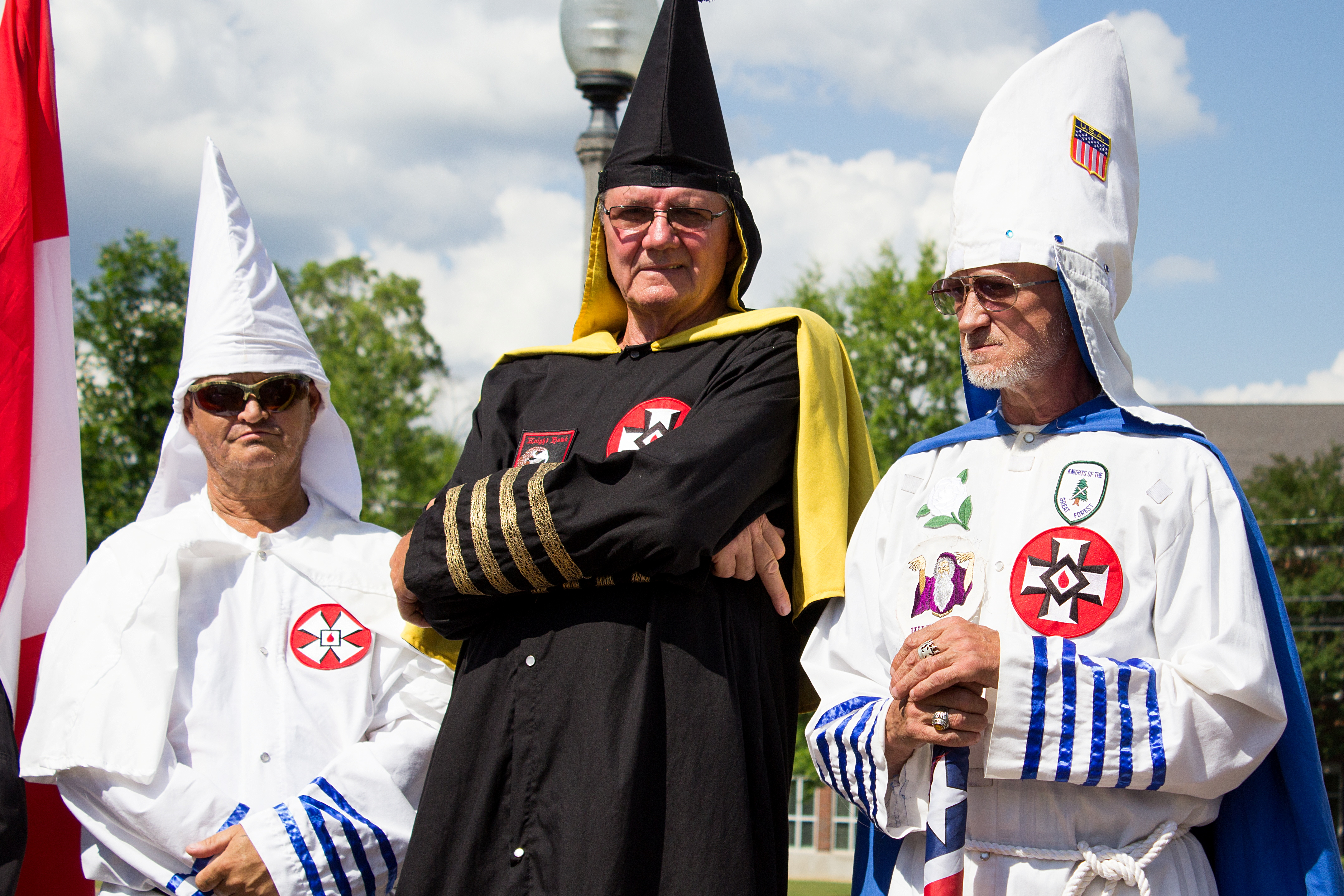 Members of the Ku Klux Klan in full regalia disrupt a speech by Camille Bennett at a Pride event in Wilson Park in Florence, Alabama, U.S., June 11, 2017.  Trevor Kiddy/Handout via REUTERS