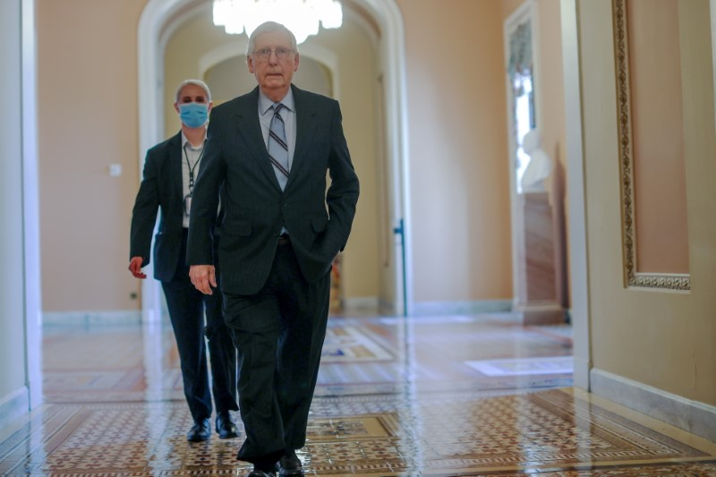 U.S. Senate Minority Leader Mitch McConnell (R-KY) walks to a Senate vote on the $1 trillion bipartisan infrastructure bill at the U.S. Capitol in Washington, U.S., August 10, 2021. REUTERS/Jonathan Ernst
