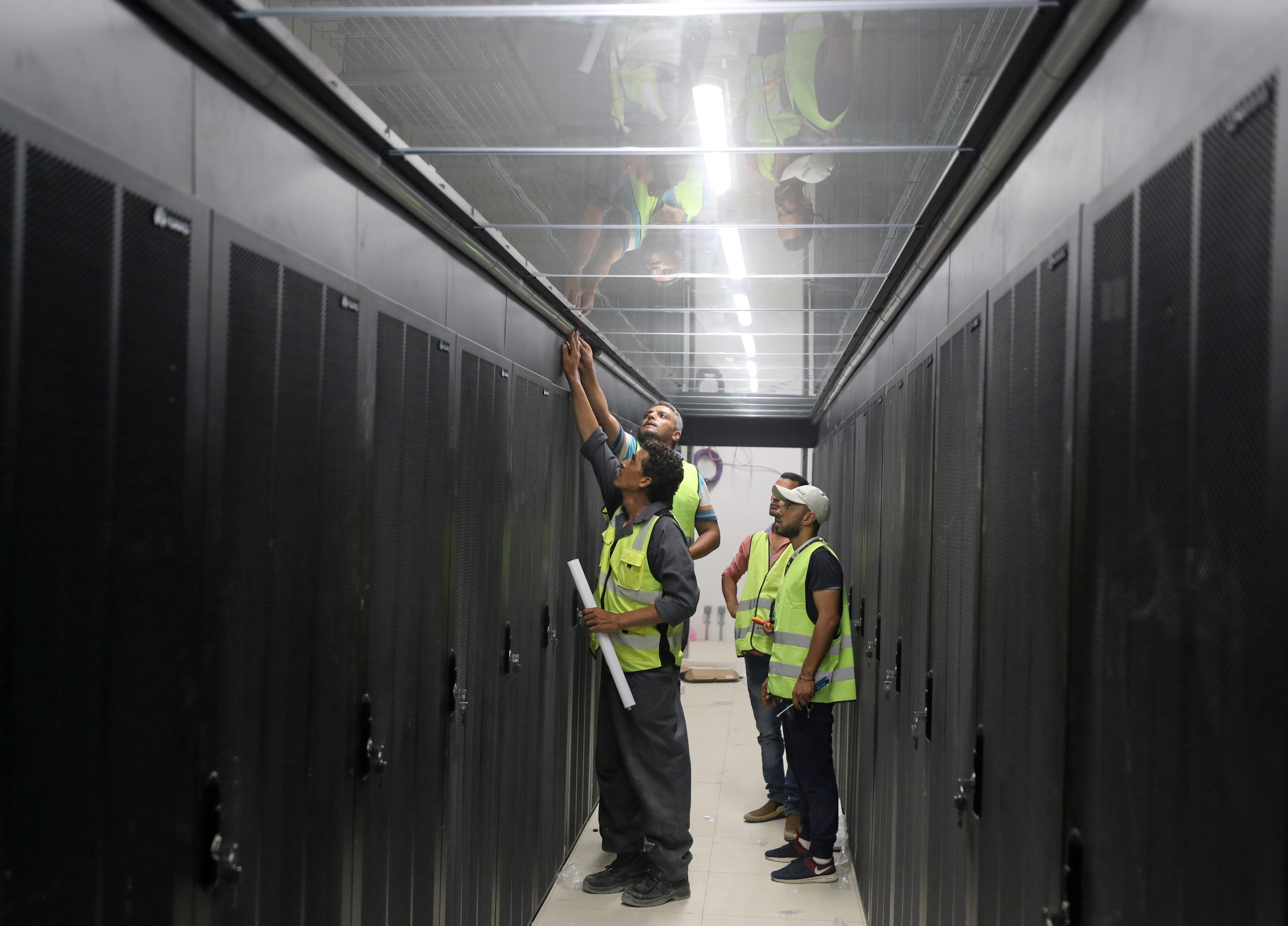 Engineers install server cabinets at an under construction data center in the New Administrative Capital (NAC) east of Cairo, Egypt July 5, 2021. Picture taken July 5, 2021. REUTERS/Mohamed Abd El Ghany