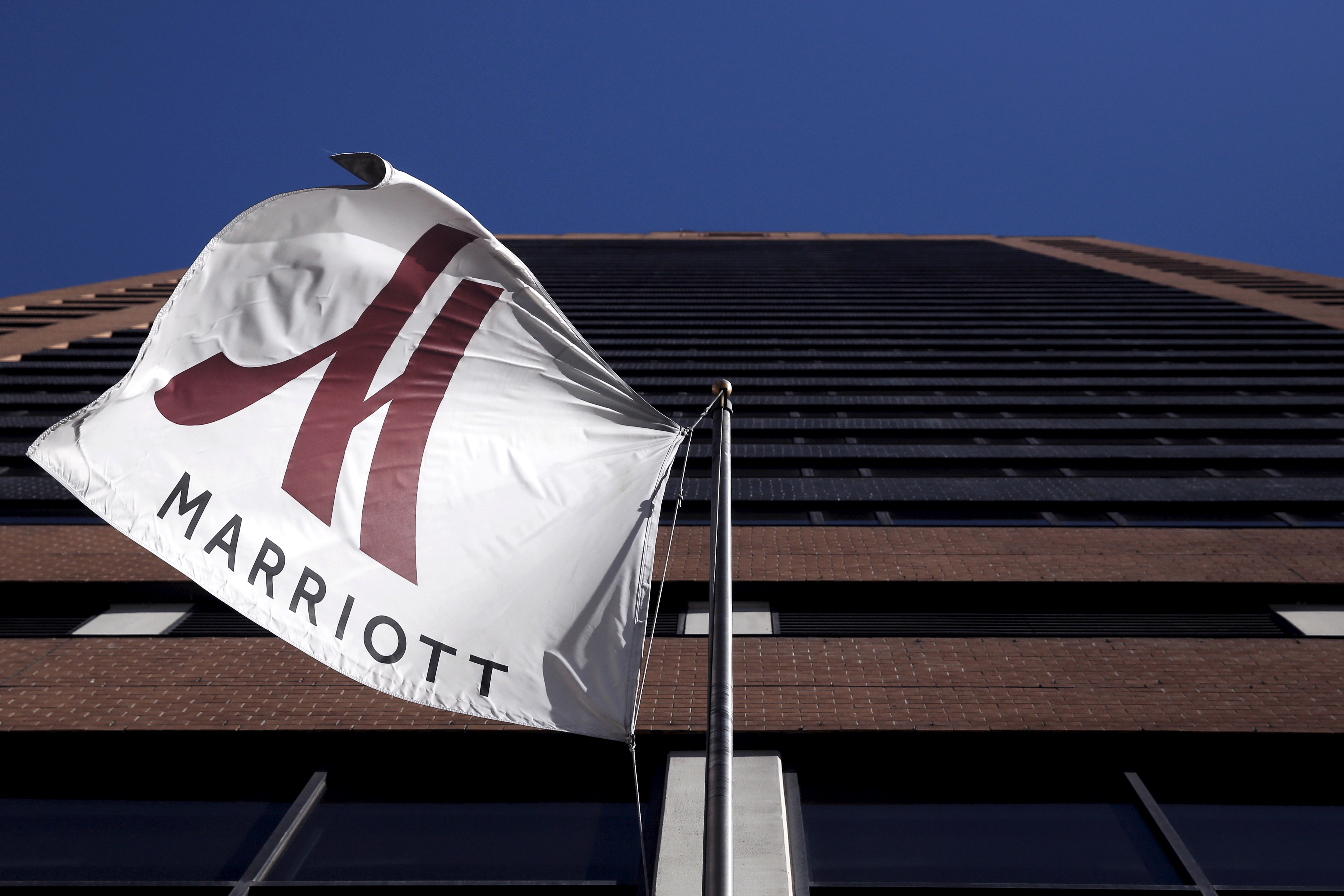 A Marriott flag hangs at the entrance of the New York Marriott Downtown hotel in Manhattan, New York November 16, 2015. REUTERS/Andrew Kelly/File Photo