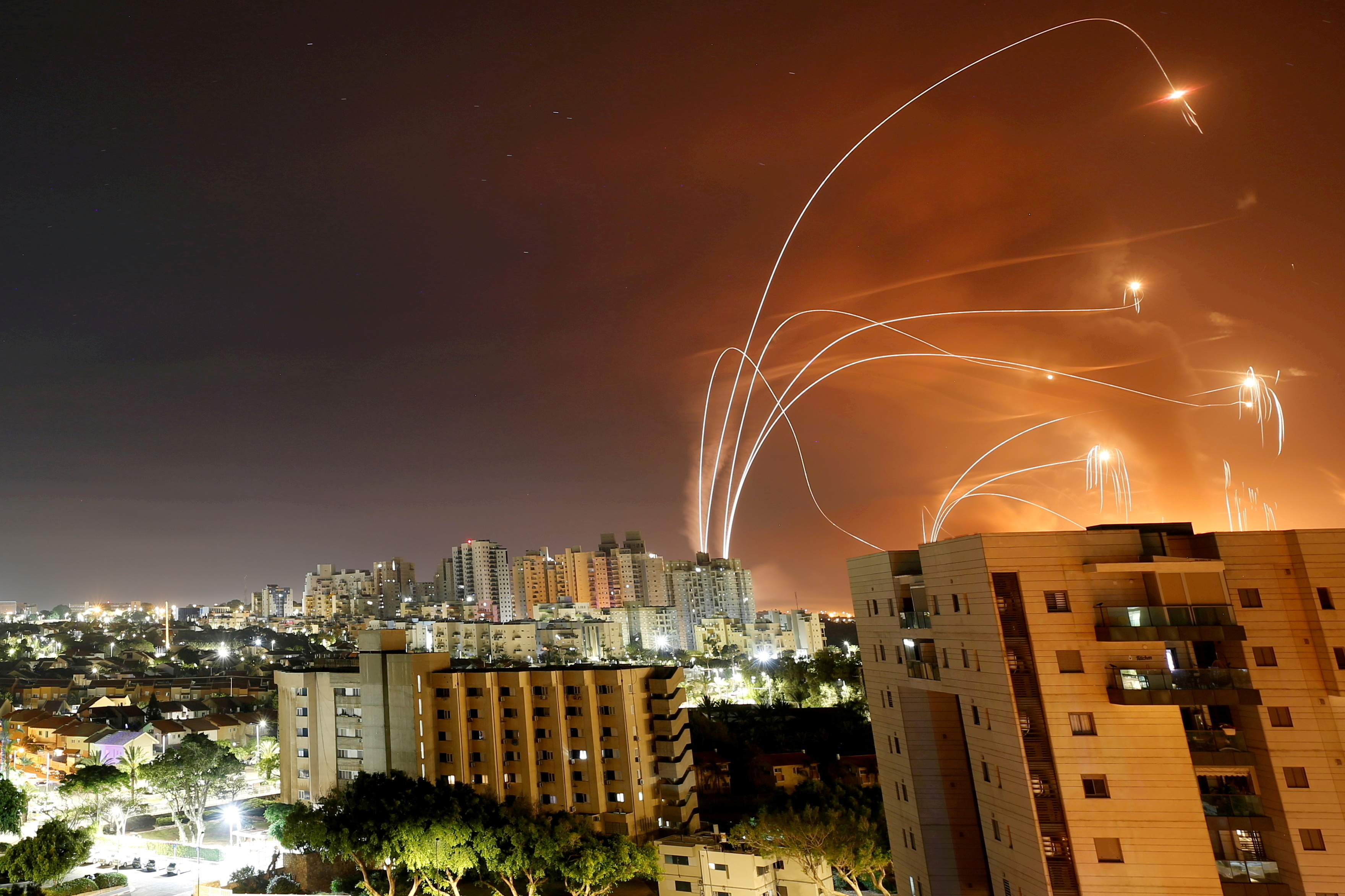 Streaks of light are seen as Israel's Iron Dome anti-missile system intercepts rockets launched from the Gaza Strip towards Israel, as seen from Ashkelon, Israel, May 12. REUTERS/Amir Cohen