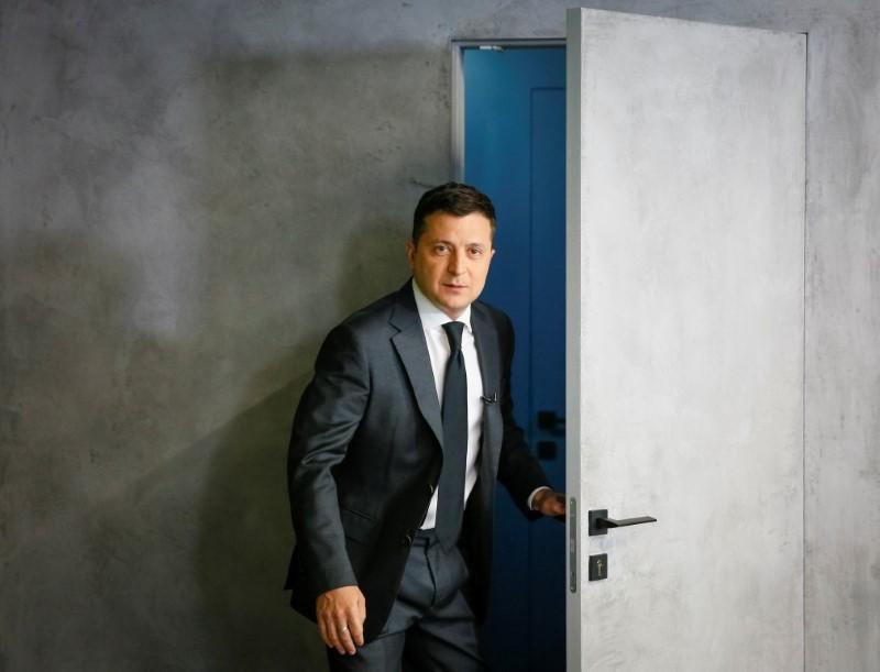 Ukrainian President Volodymyr Zelenskiy walks in for an interview in Kyiv, Ukraine June 14, 2021. REUTERS/Gleb Garanich