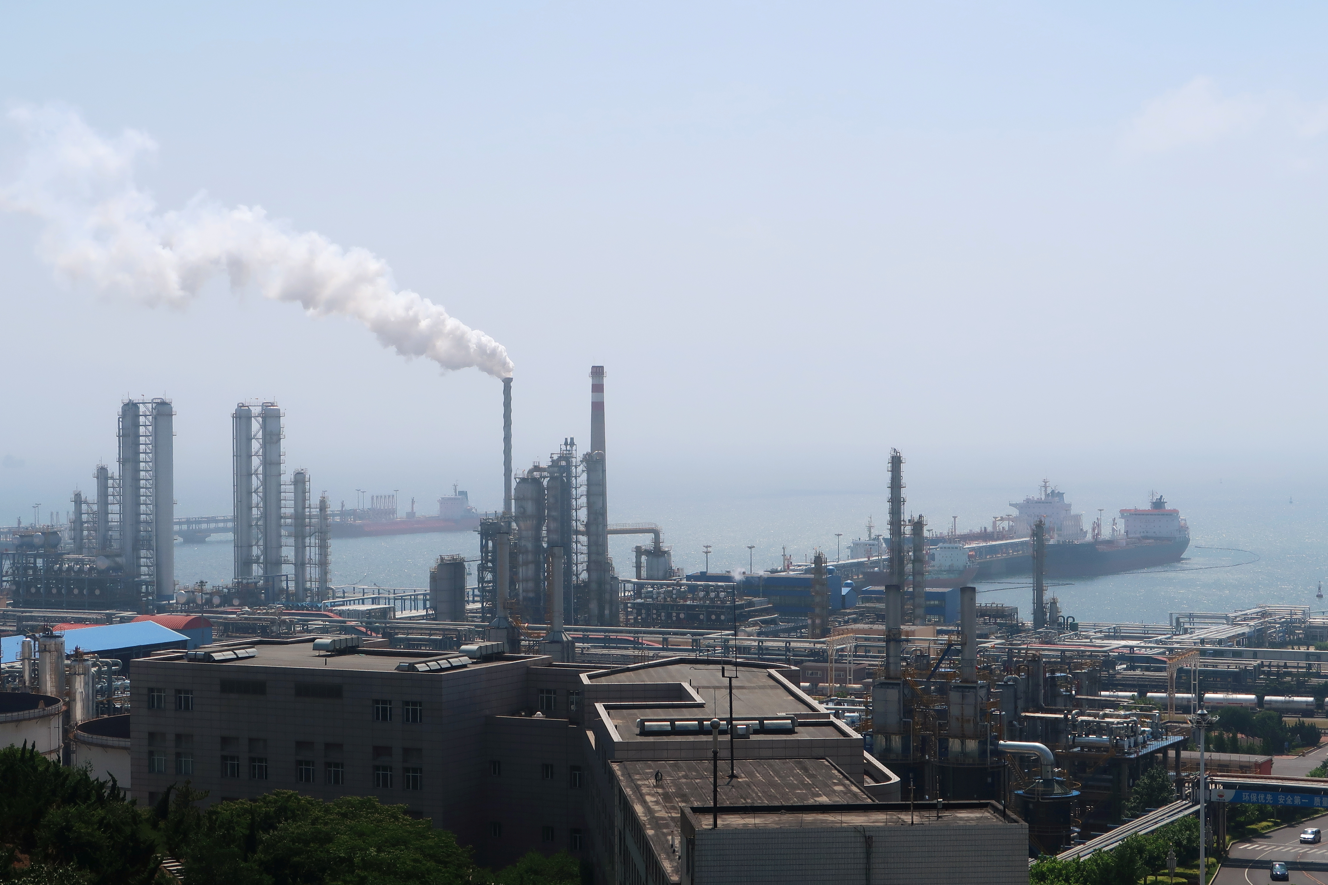 China National Petroleum Corporation (CNPC)'s Dalian Petrochemical Corp refinery is seen near the downtown of Dalian in Liaoning province, China July 17, 2018. Picture taken July 17, 2018. REUTERS/Chen Aizhu/Files