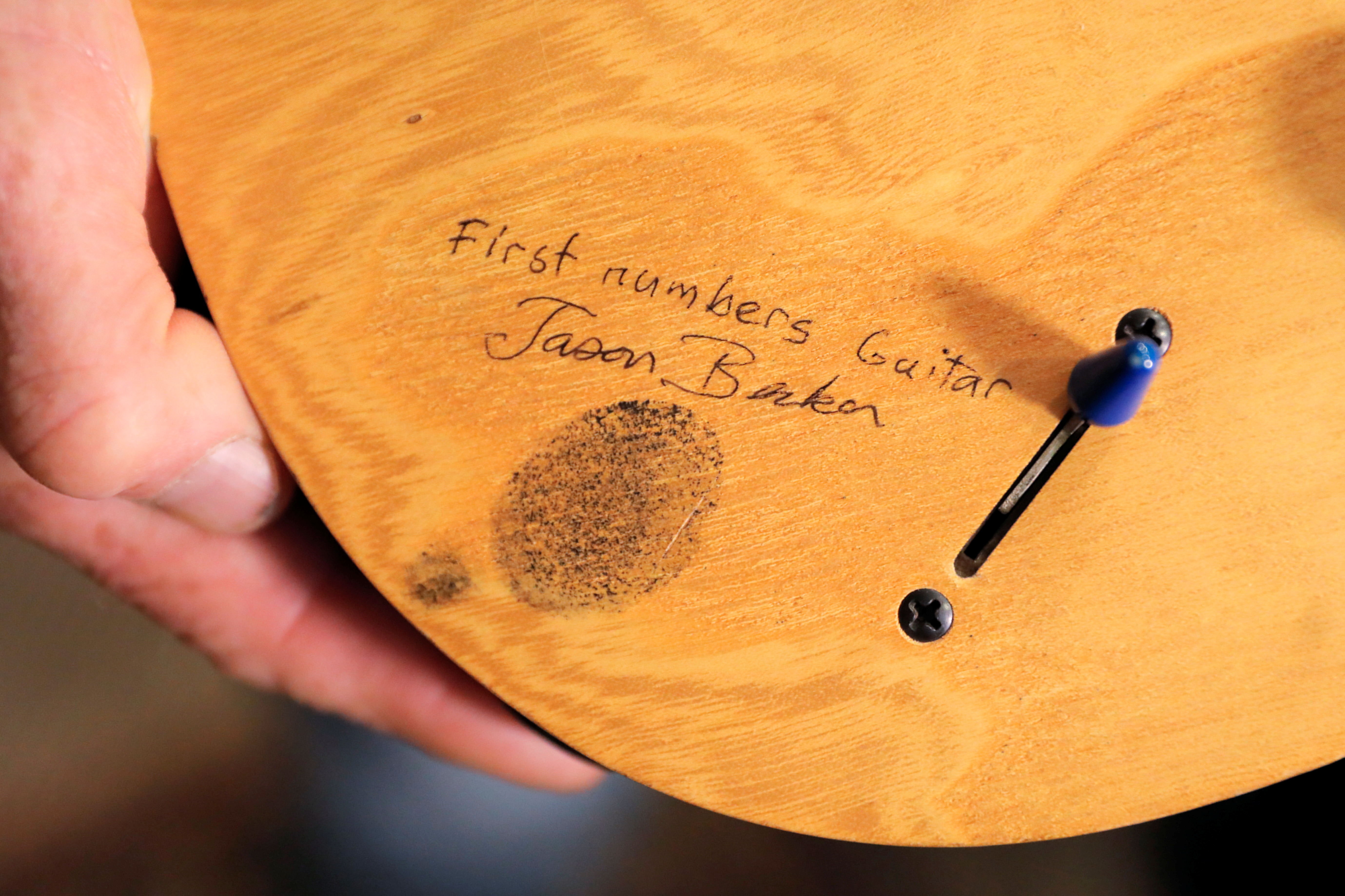 The thumb print of guitar player Jason Becker is seen on his
