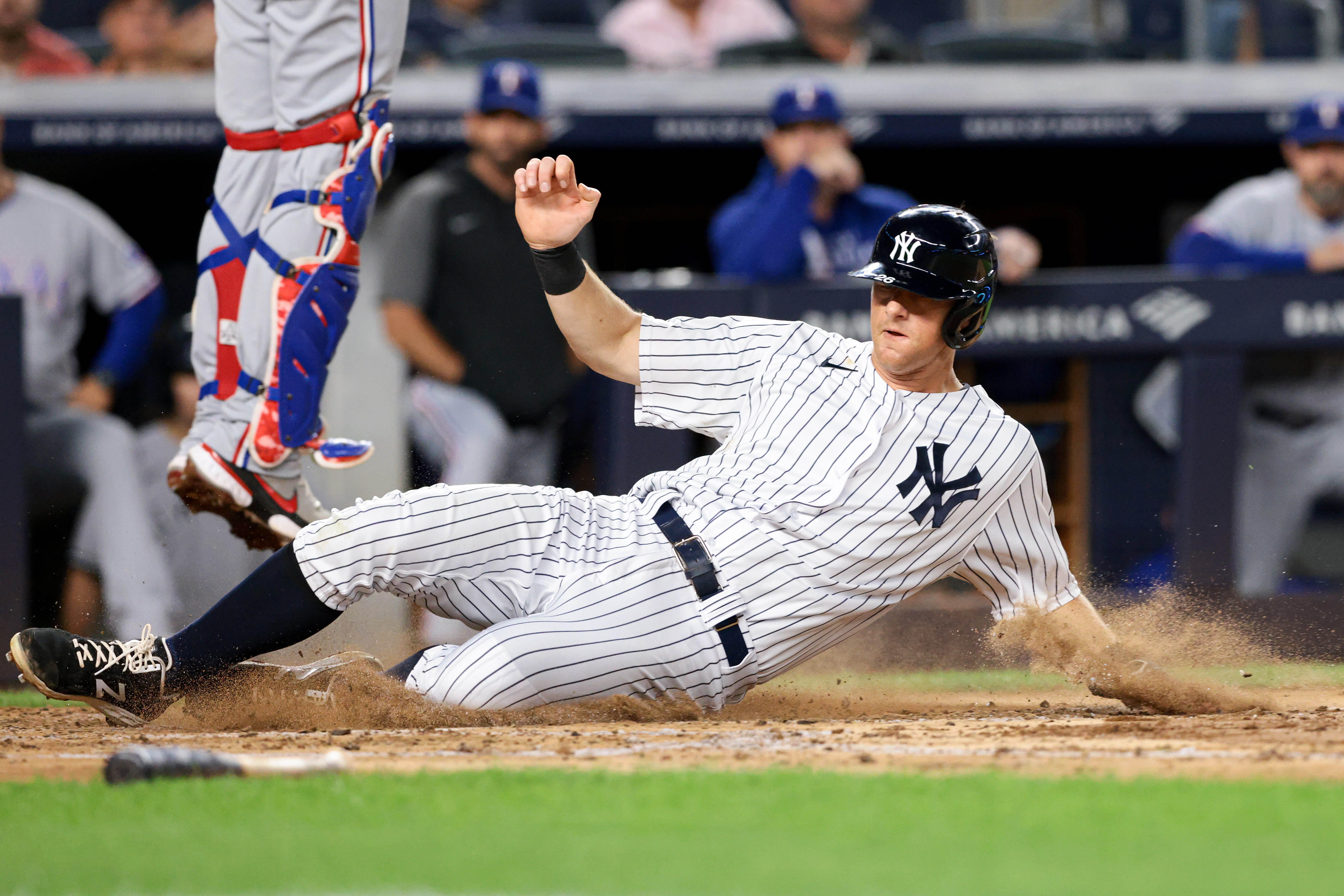 Sep 20, 2021; Bronx, New York, USA; New York Yankees second baseman DJ LeMahieu (26) scores on a RBI single by Aaron Judge (not pictured) against the Texas Rangers during the third inning at Yankee Stadium. Mandatory Credit: Vincent Carchietta-USA TODAY Sports