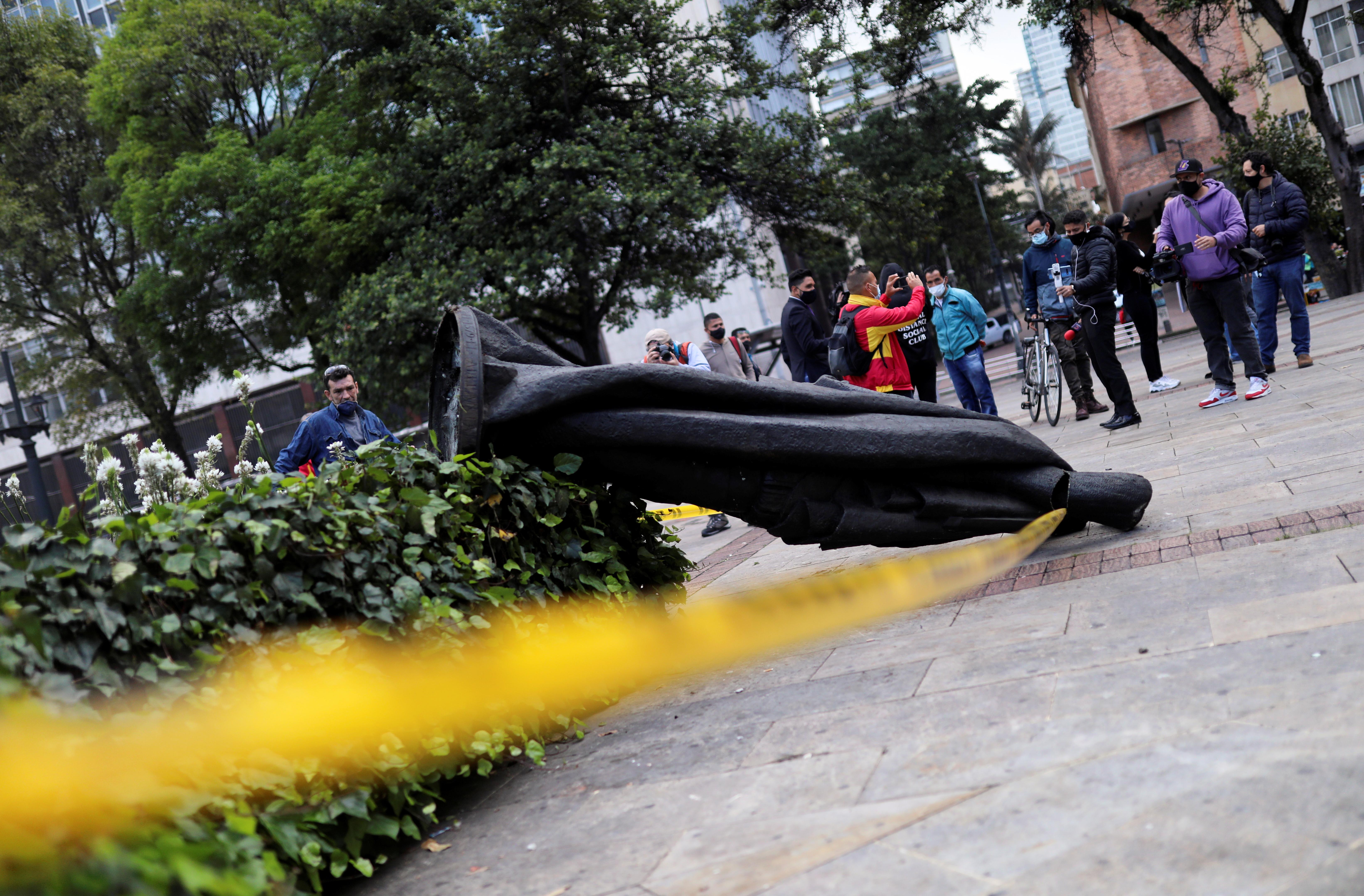 Statue of Spanish conqueror Gonzalo Jimenez de Quesada is demolished by Indigenous Misak in Bogota, Colombia May 7, 2021. REUTERS/Luisa Gonzalez