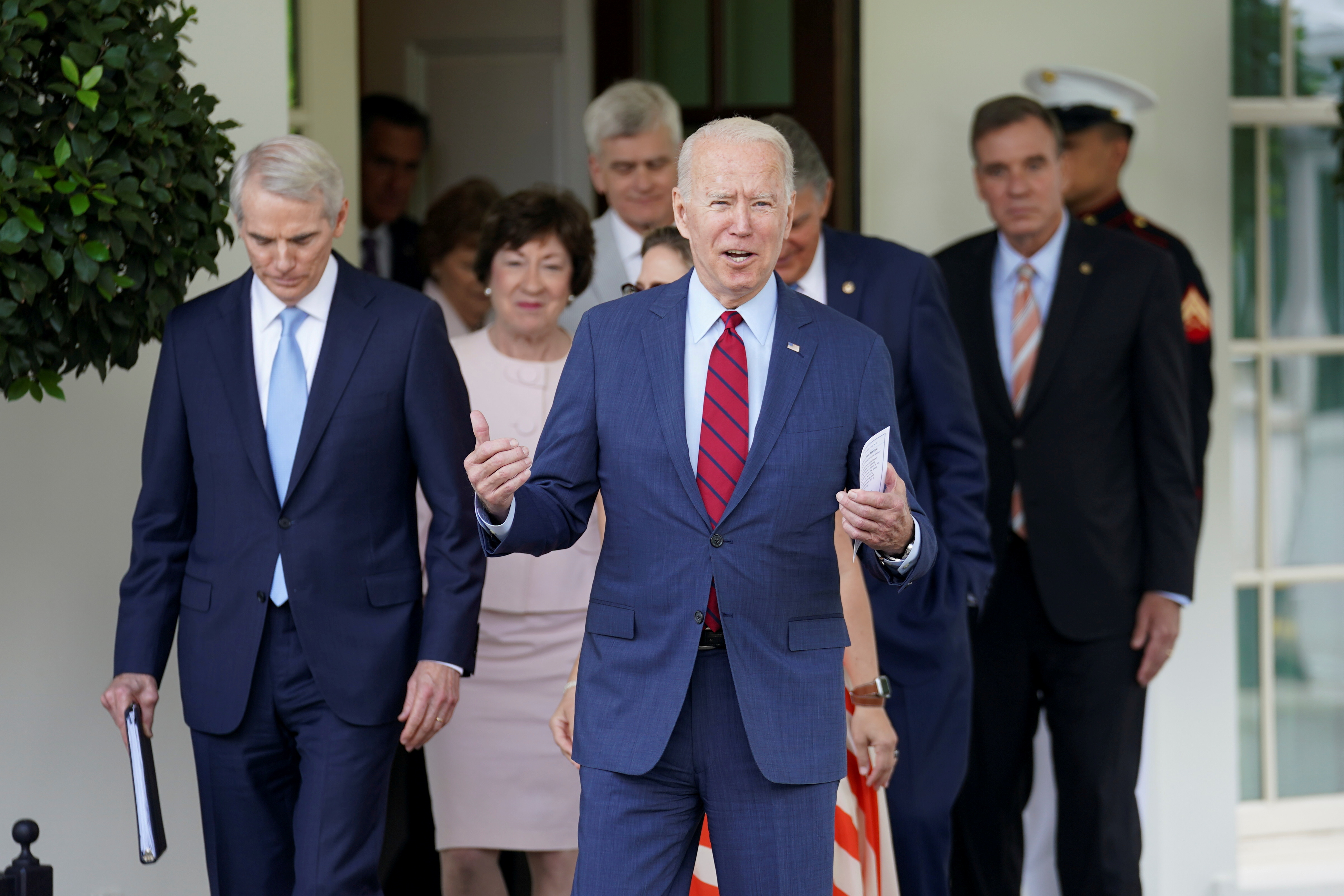 U.S. President Joe Biden exits the West Wing of the White House for talking to the media, following a bipartisan meeting with U.S. senators about the proposed framework for the infrastructure bill, at the White House in Washington, U.S., June 24, 2021. REUTERS/Kevin Lamarque