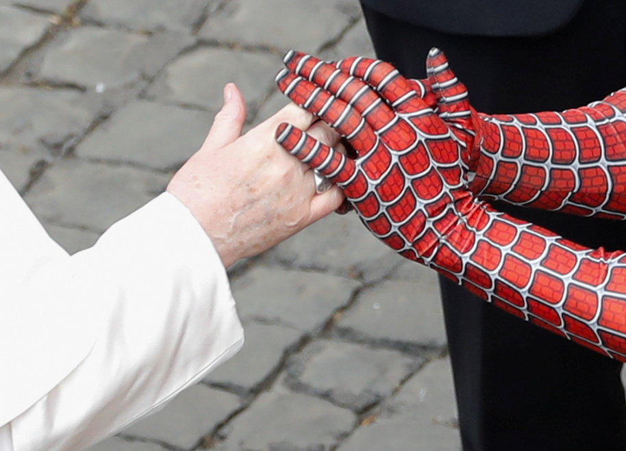 Pope Francis greets a person dressed as Spiderman after the general audience, amid the coronavirus disease (COVID-19) pandemic, at the Vatican, June 23, 2021. REUTERS/Remo Casilli