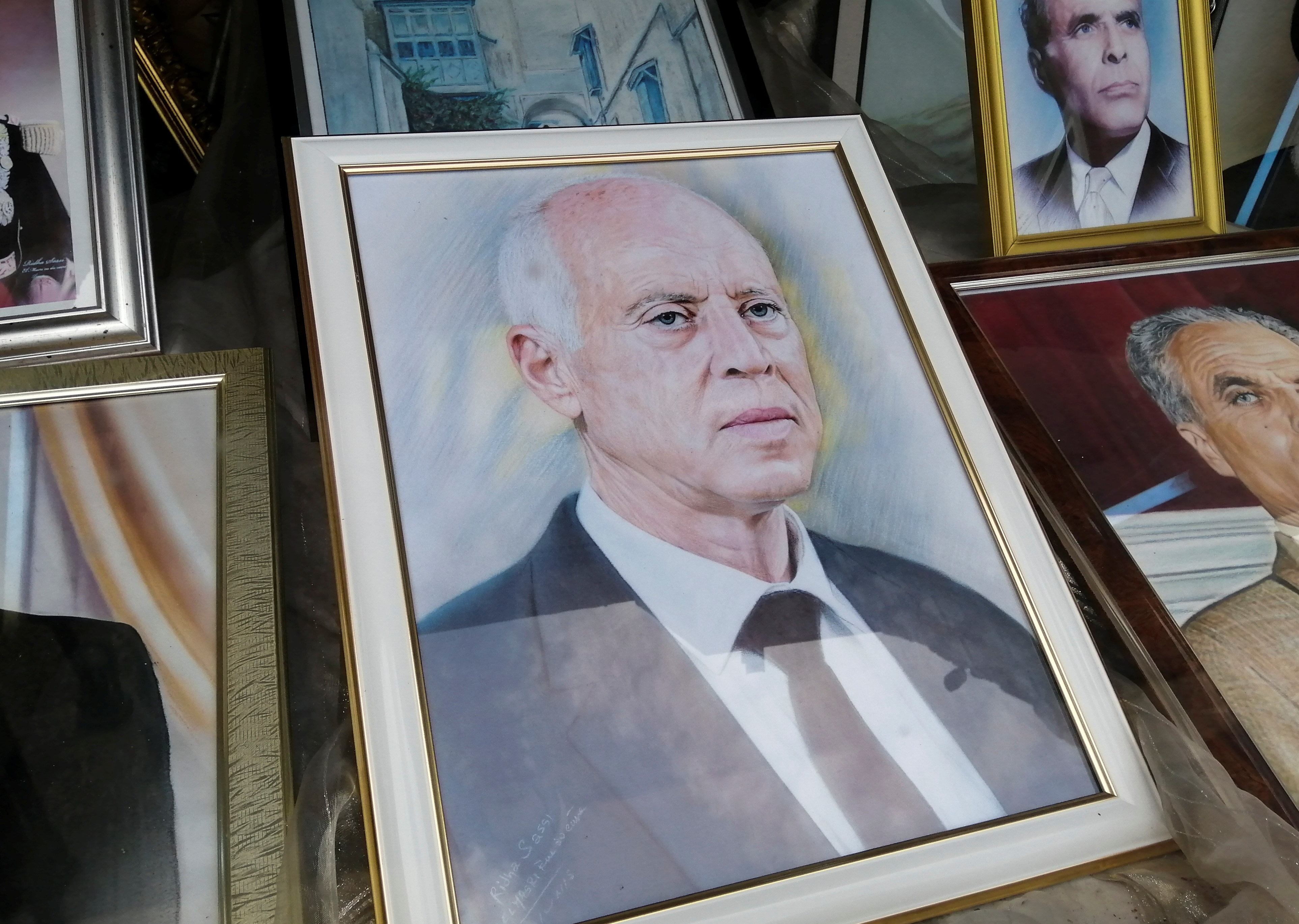 A portrait of Tunisian President Kais Saied is displayed inside a photography shop in Tunis, Tunisia September 23, 2021. REUTERS/Jihed Abidellaoui