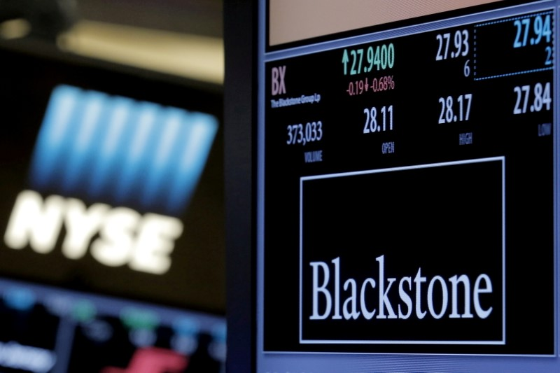 The ticker and trading information for Blackstone Group is displayed at the post where it is traded on the floor of the New York Stock Exchange (NYSE) April 4, 2016. REUTERS/Brendan McDermid//File Photo