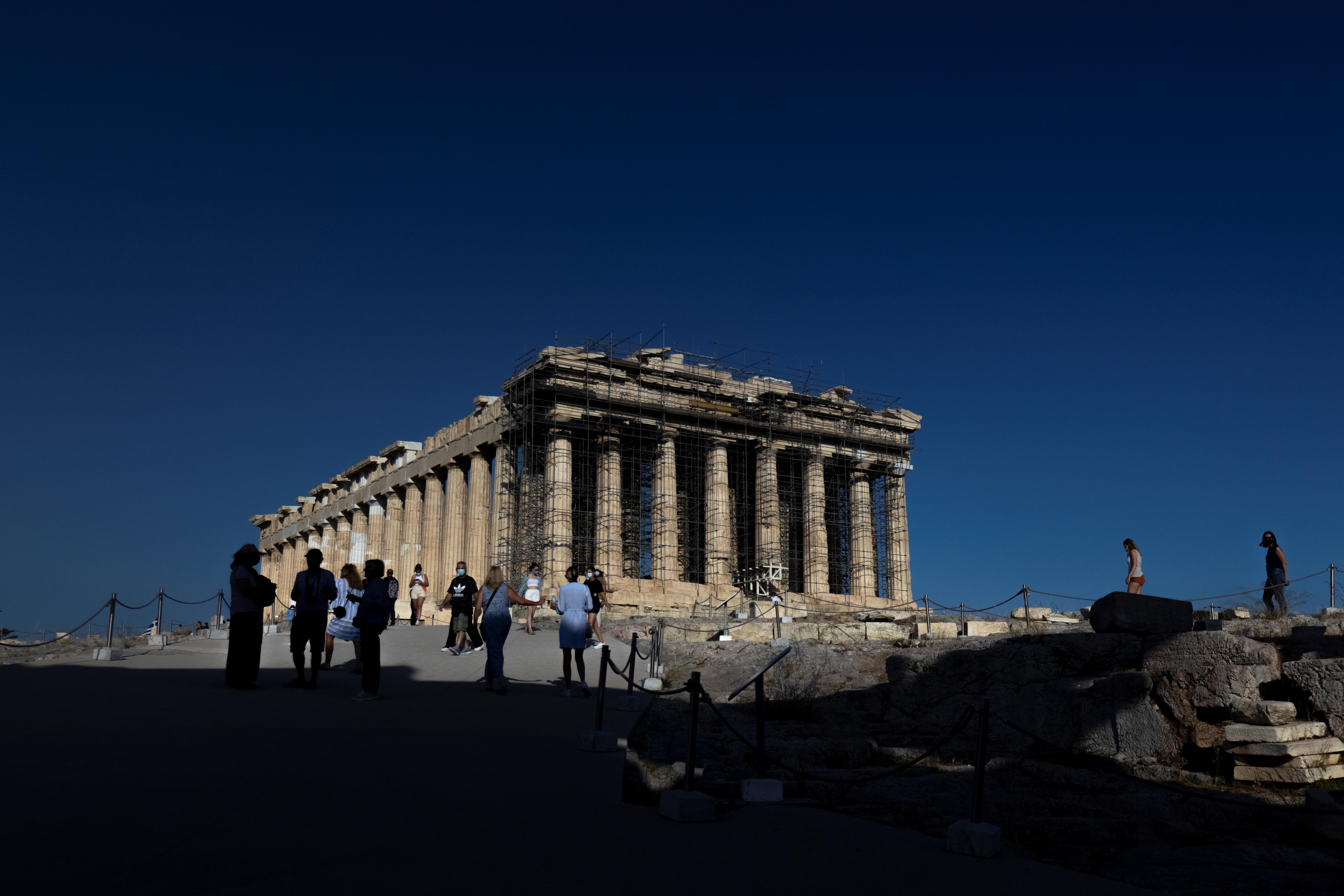 People visit the Parthenon temple atop the Acropolis hill in Athens, Greece, June 8, 2021. REUTERS/Alkis Konstantinidis