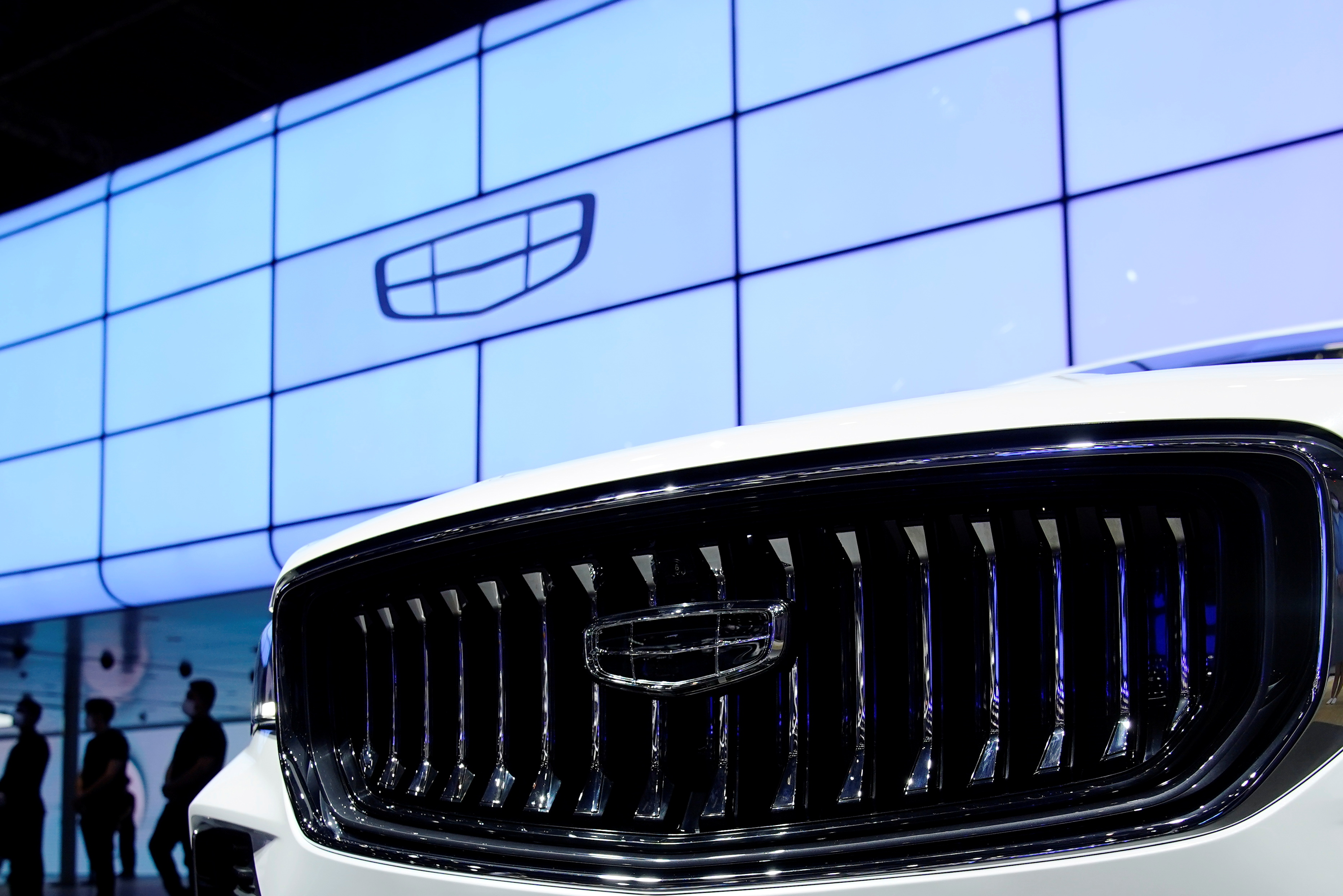 The Geely logo is seen on its vehicle during a media day for the Auto Shanghai show in Shanghai, China April 19, 2021. REUTERS/Aly Song