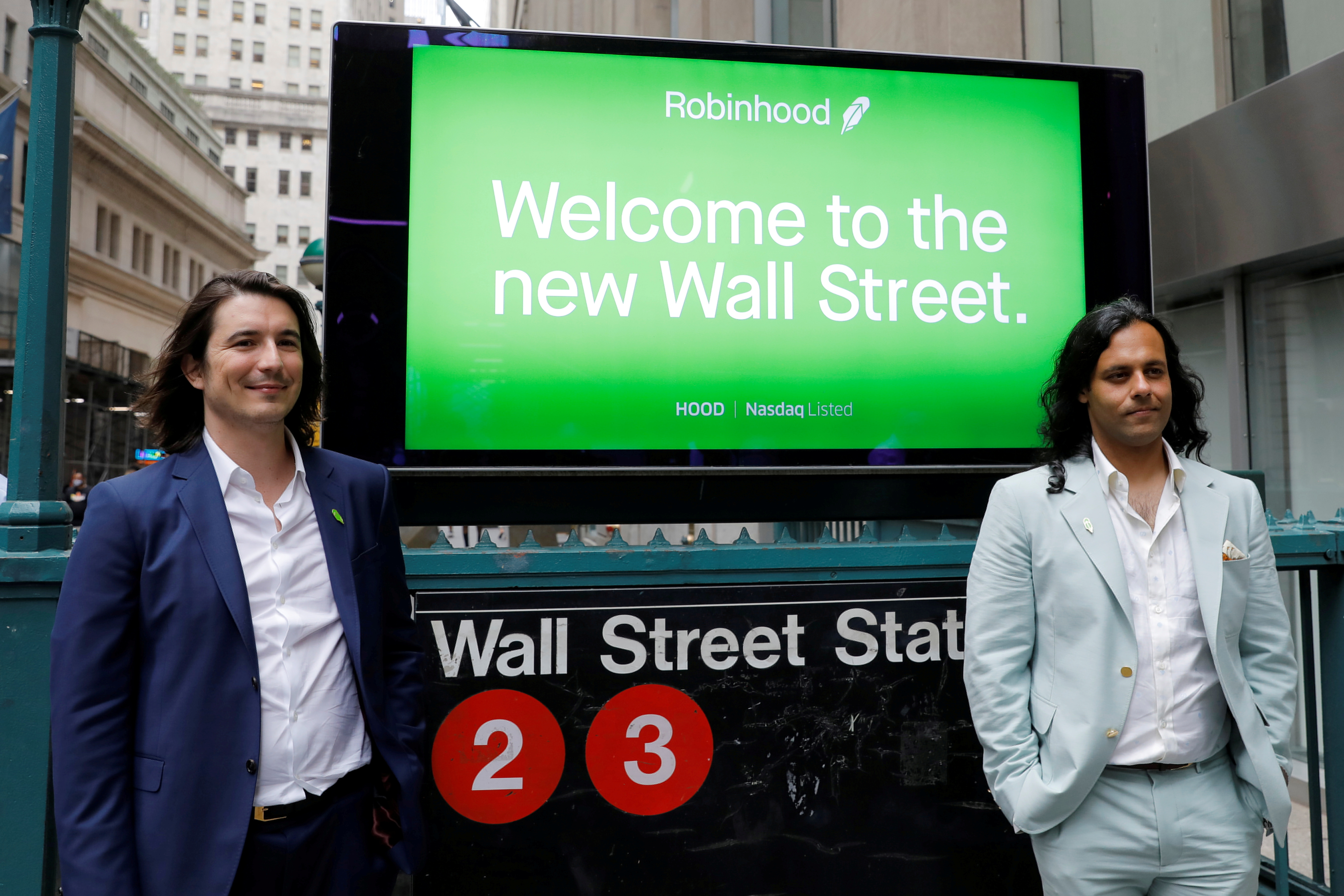 Robinhood Markets, Inc. CEO and co-founder Vlad Tenev and co-founder Baiju Bhatt pose with Robinhood signage on Wall Street after the company's IPO in New York City, U.S., July 29, 2021.  REUTERS/Andrew Kelly/File Photo