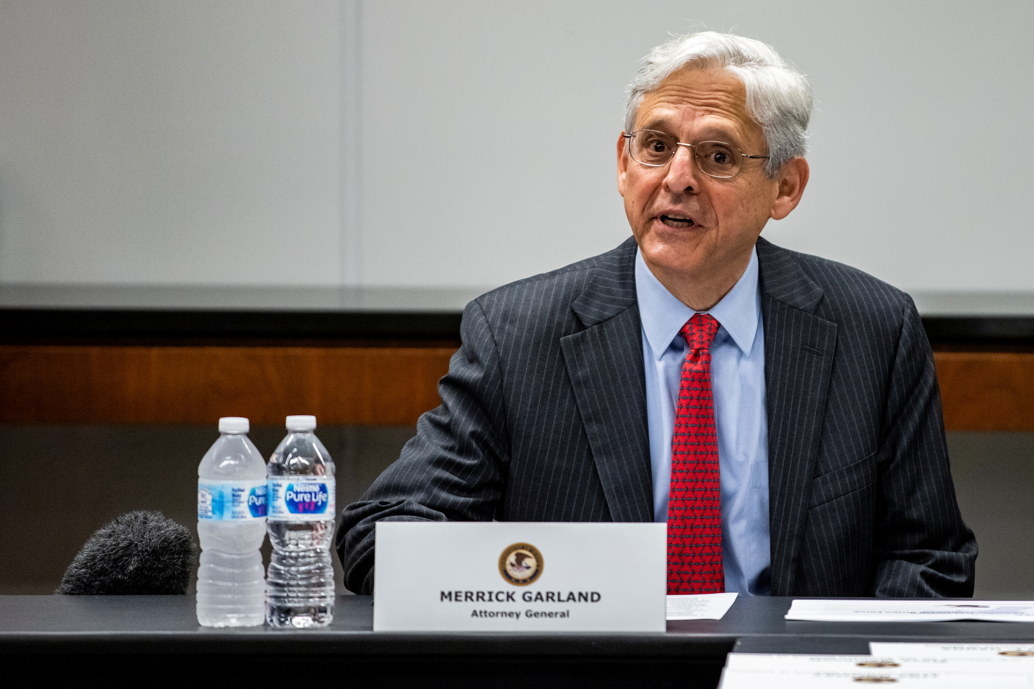 U.S. Attorney General Merrick Garland attends a meeting with various law enforcement leadership and Illinois-area Strike Force Teams at the U.S. Attorney's Office as an initiative was announced today to reduce gun violence with five cross-jurisdictional strike forces by disrupting illegal firearms trafficking in key U.S. regions, in Chicago, Illinois, U.S., July 23, 2021. Samuel Corum/Pool via REUTERS