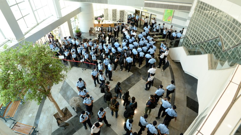 Police officers gather at the headquarters of Apple Daily in Hong Kong, China June 17, 2021. Apple Daily/Handout via REUTERS