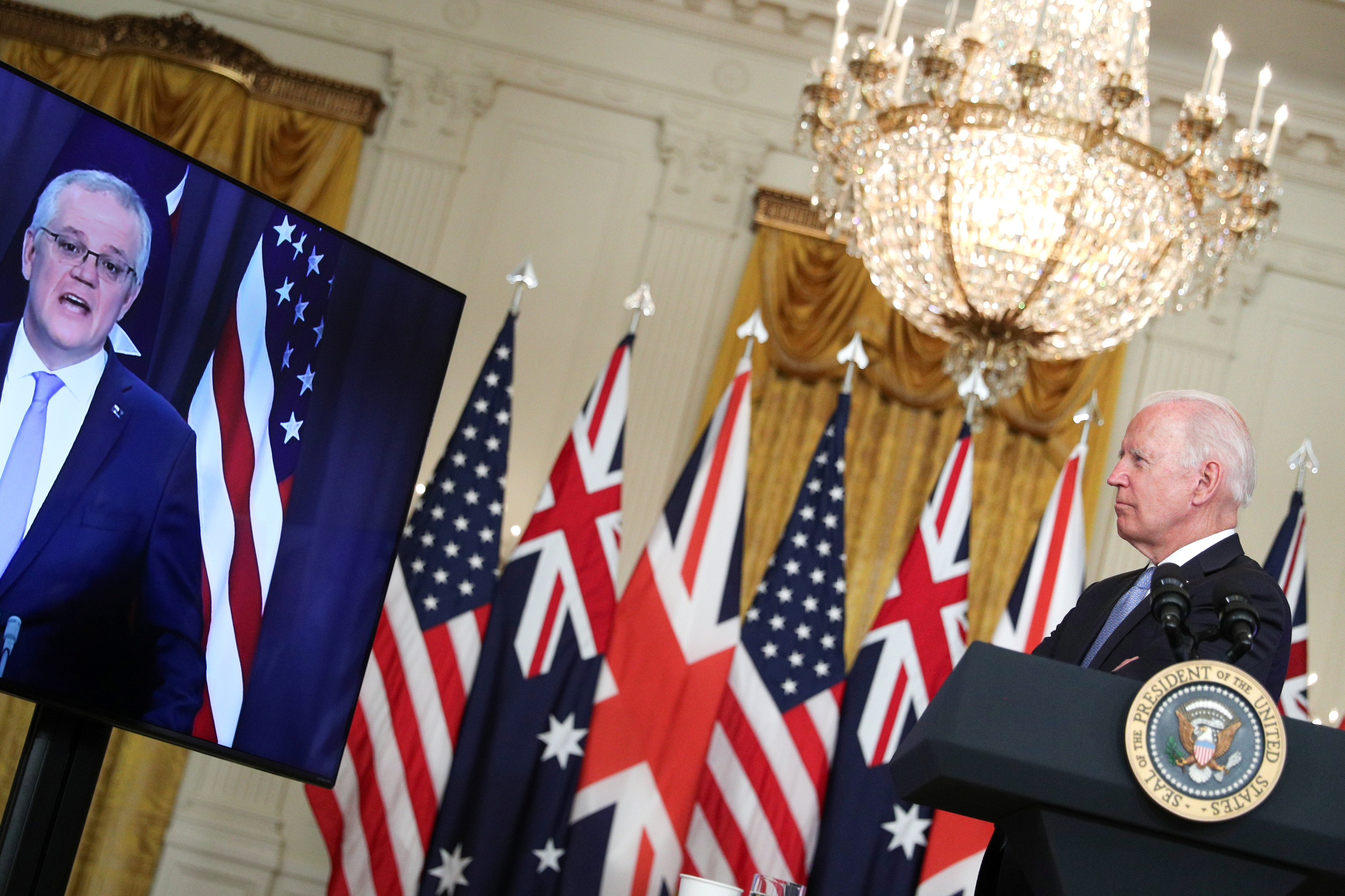 U.S. President Joe Biden delivers remarks on a National Security Initiative virtually with Australian Prime Minister Scott Morrison and British Prime Minister Boris Johnson, not pictured, inside the East Room at the White House in Washington, U.S., September 15, 2021.  REUTERS/Tom Brenner
