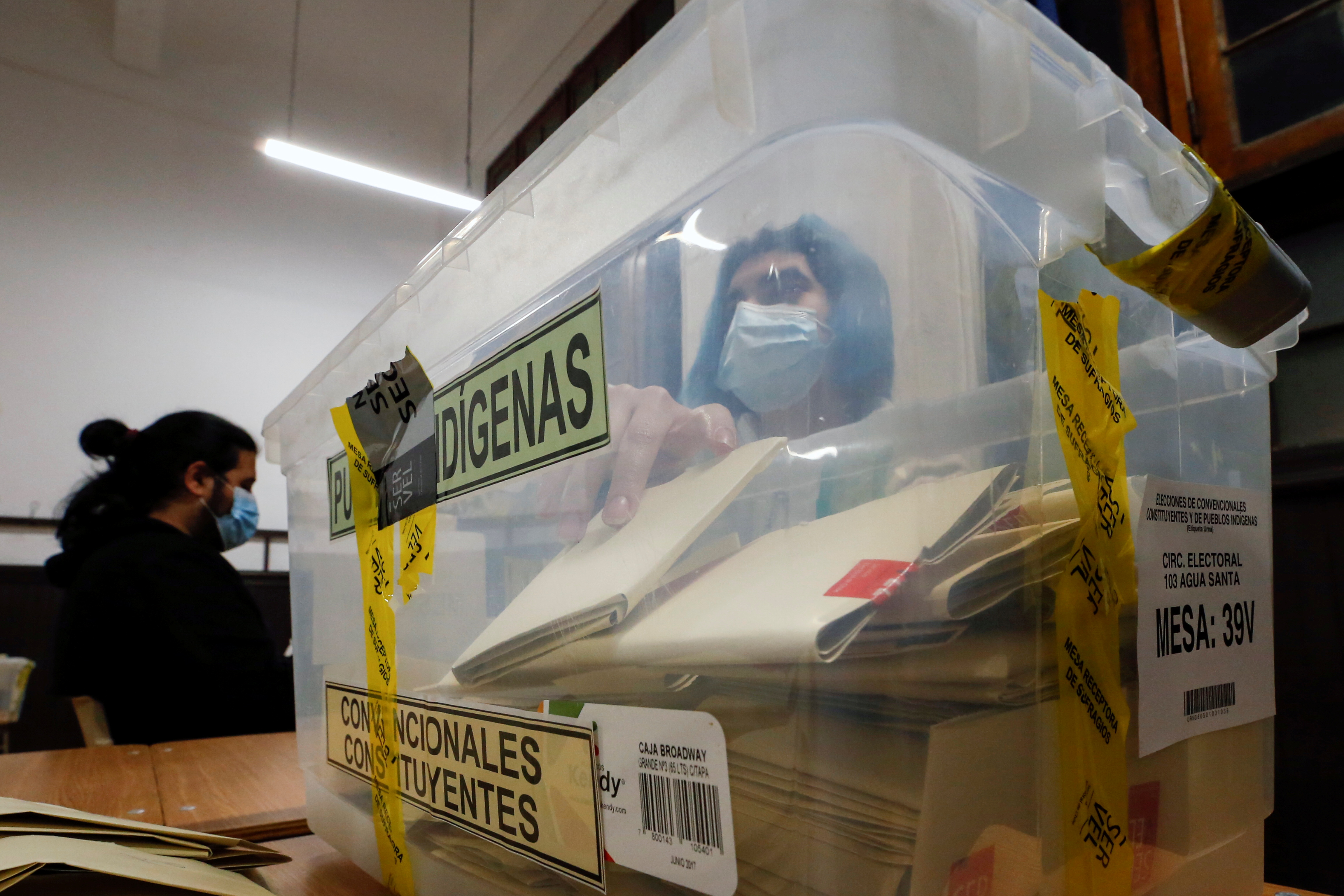 A poll worker wearing protective mask counts the votes in a ballot box after polls closed during the elections for governors, mayors, councillors and constitutional assembly members to draft a new constitution to replace Chile's charter, in Valparaiso, Chile, May 16, 2021. REUTERS/Rodrigo Garrido
