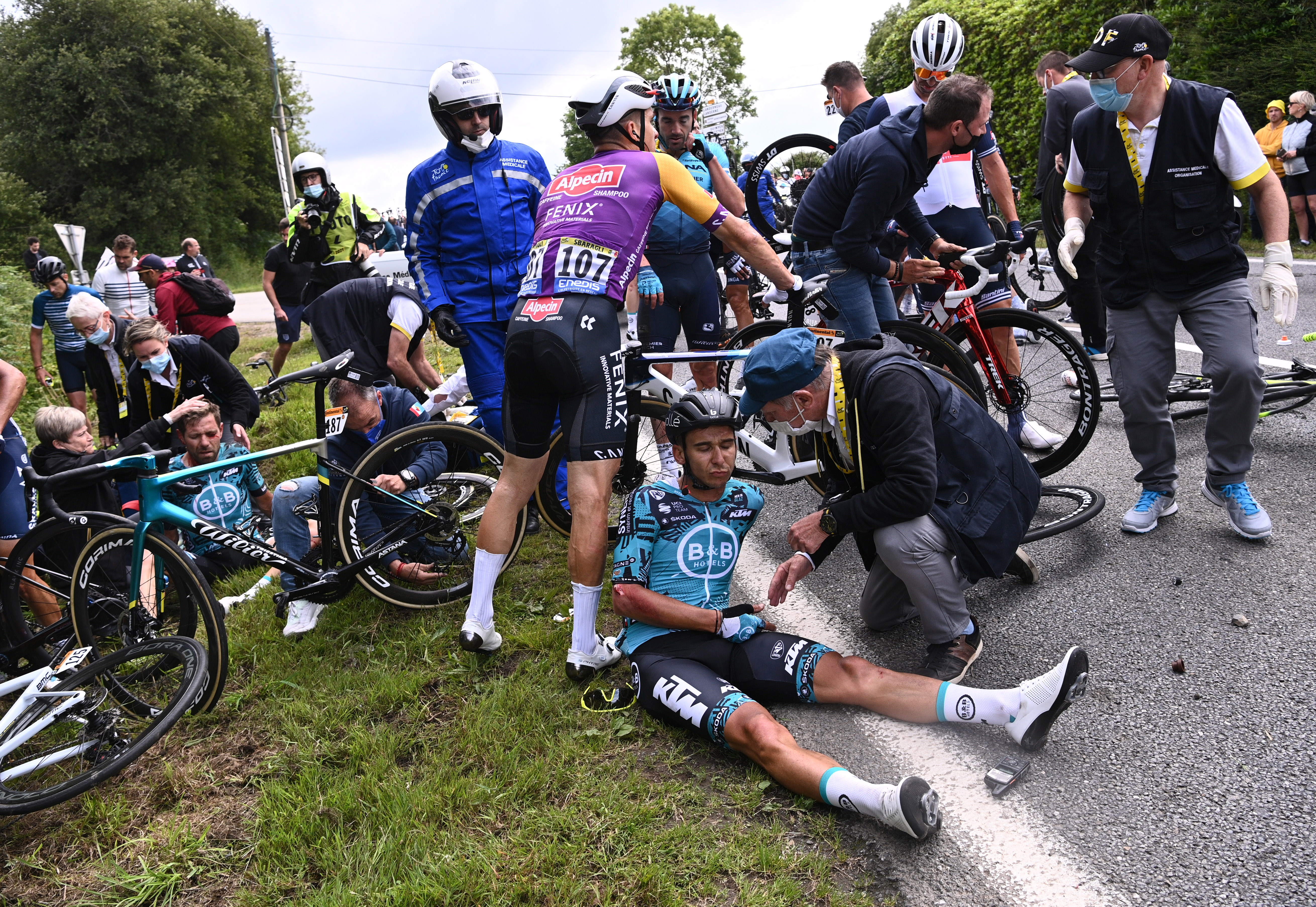 Cycling - Tour de France - Stage 1 - Brest to Landerneau - France - June 26, 2021 B&B Hotels p/b KTM rider Cyril Lemoine of France receives medical attention Pool via REUTERS/Anne-Christine Poujoulat