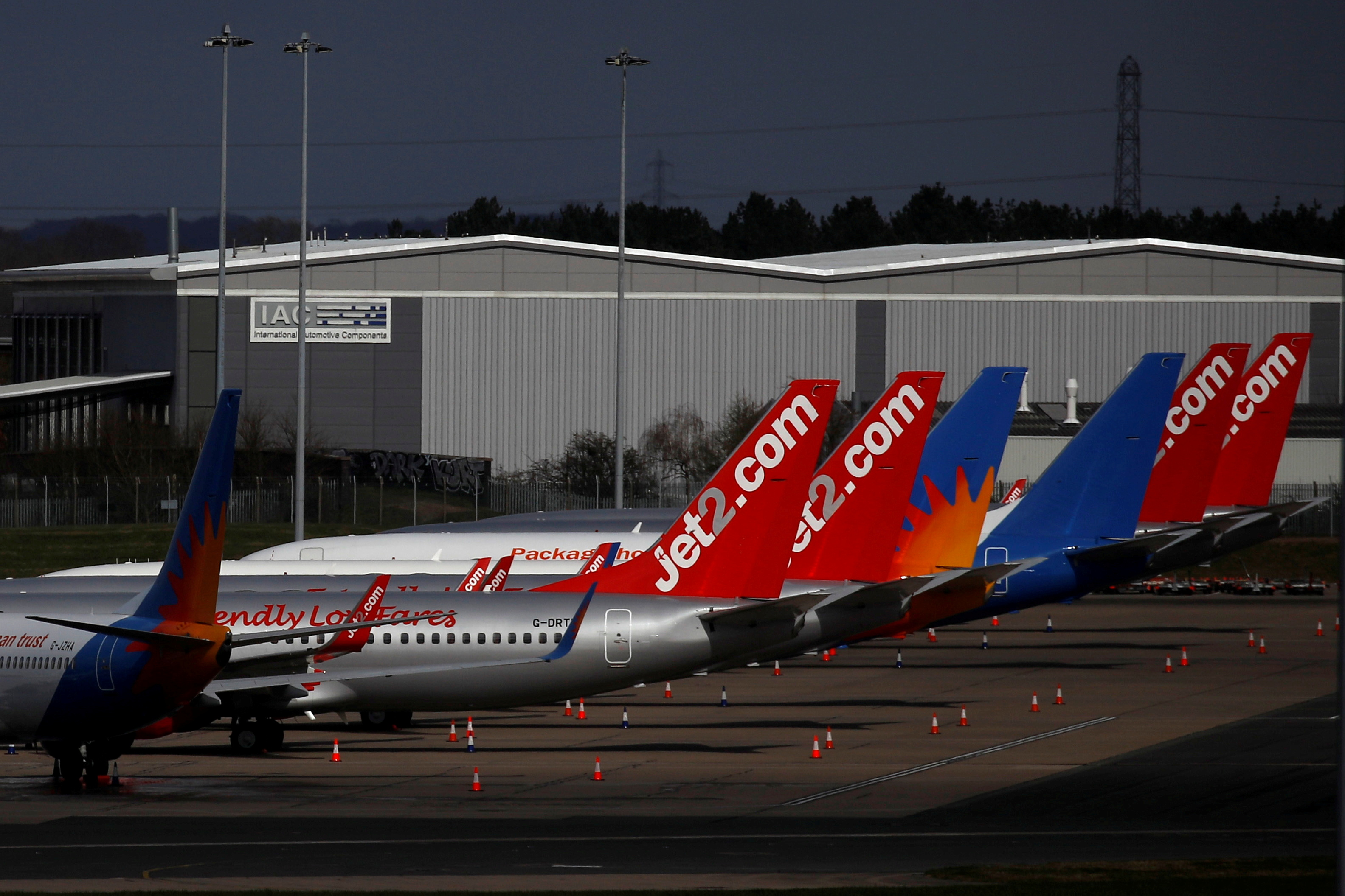 Jet2 planes are seen parked at Birmingham airport as the spread of the coronavirus disease (COVID-19) continues, Birmingham, Britain, March 28, 2020. REUTERS/Phil Noble