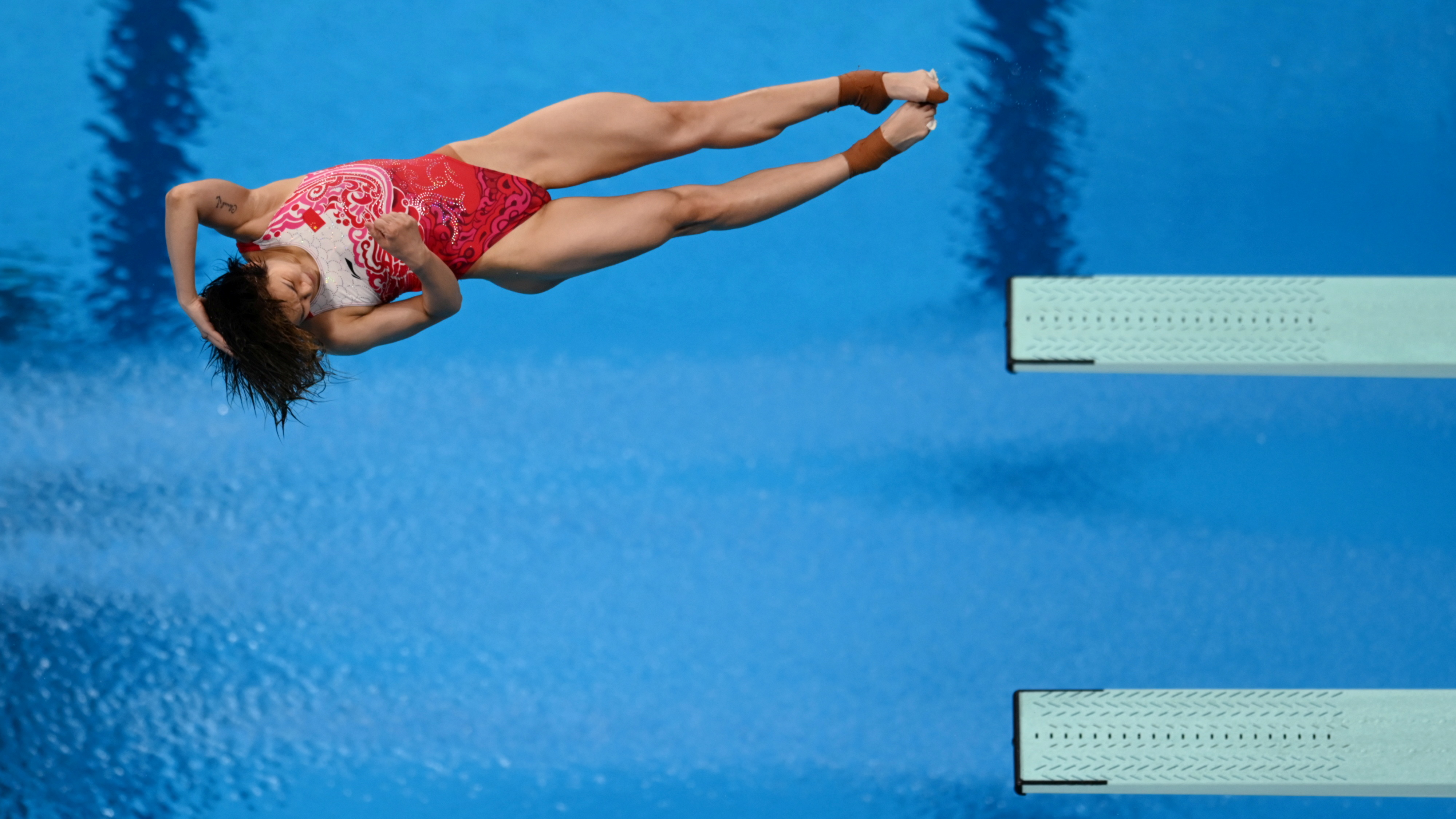 Tokyo 2020 Olympics - Diving - Women's 3m Springboard - Final - Tokyo Aquatics Centre, Tokyo, Japan - August 1, 2021. Tingmao Shi of China in action during the last dive REUTERS/Annegret Hilse