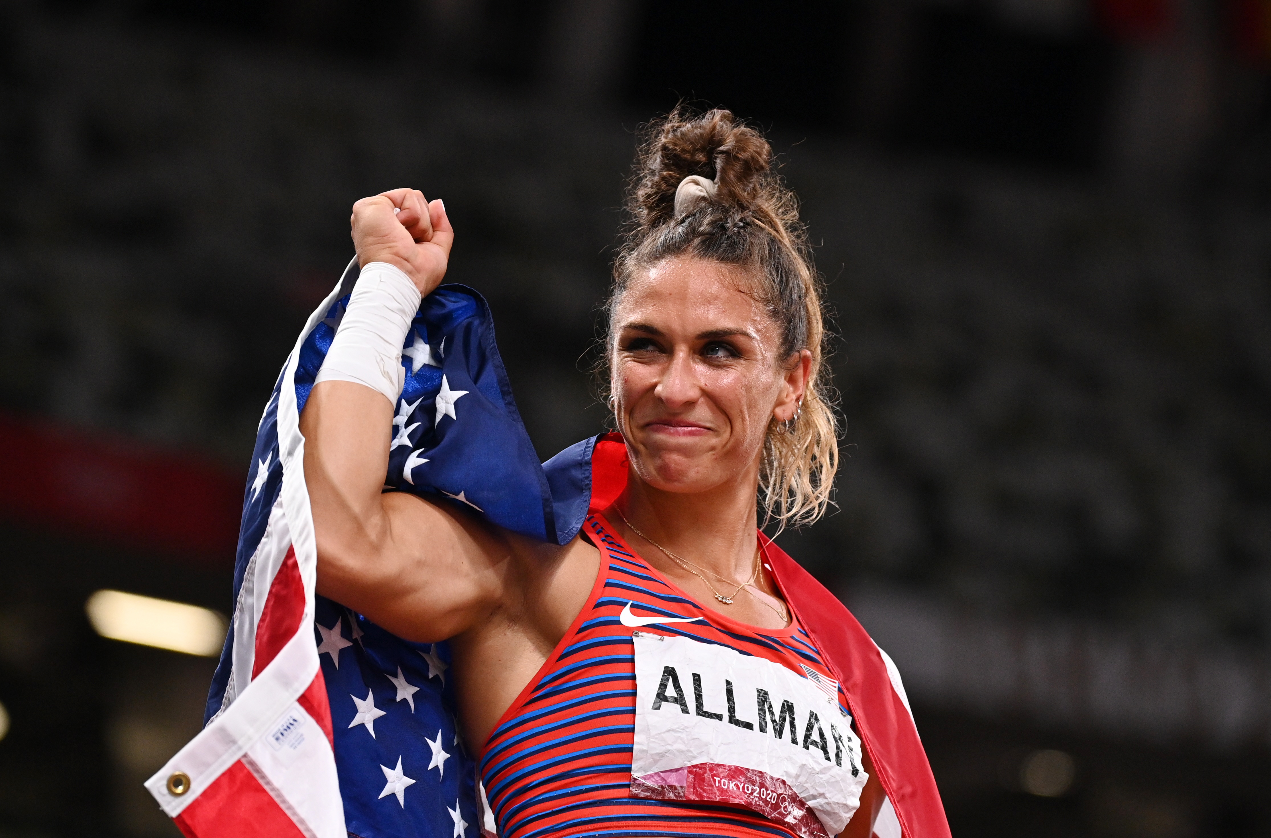 Tokyo 2020 Olympics - Athletics - Women's Discus Throw - Final - Olympic Stadium, Tokyo, Japan - August 2, 2021. Valarie Allman of the United States celebrates with her national flag after winning gold REUTERS/Dylan Martinez