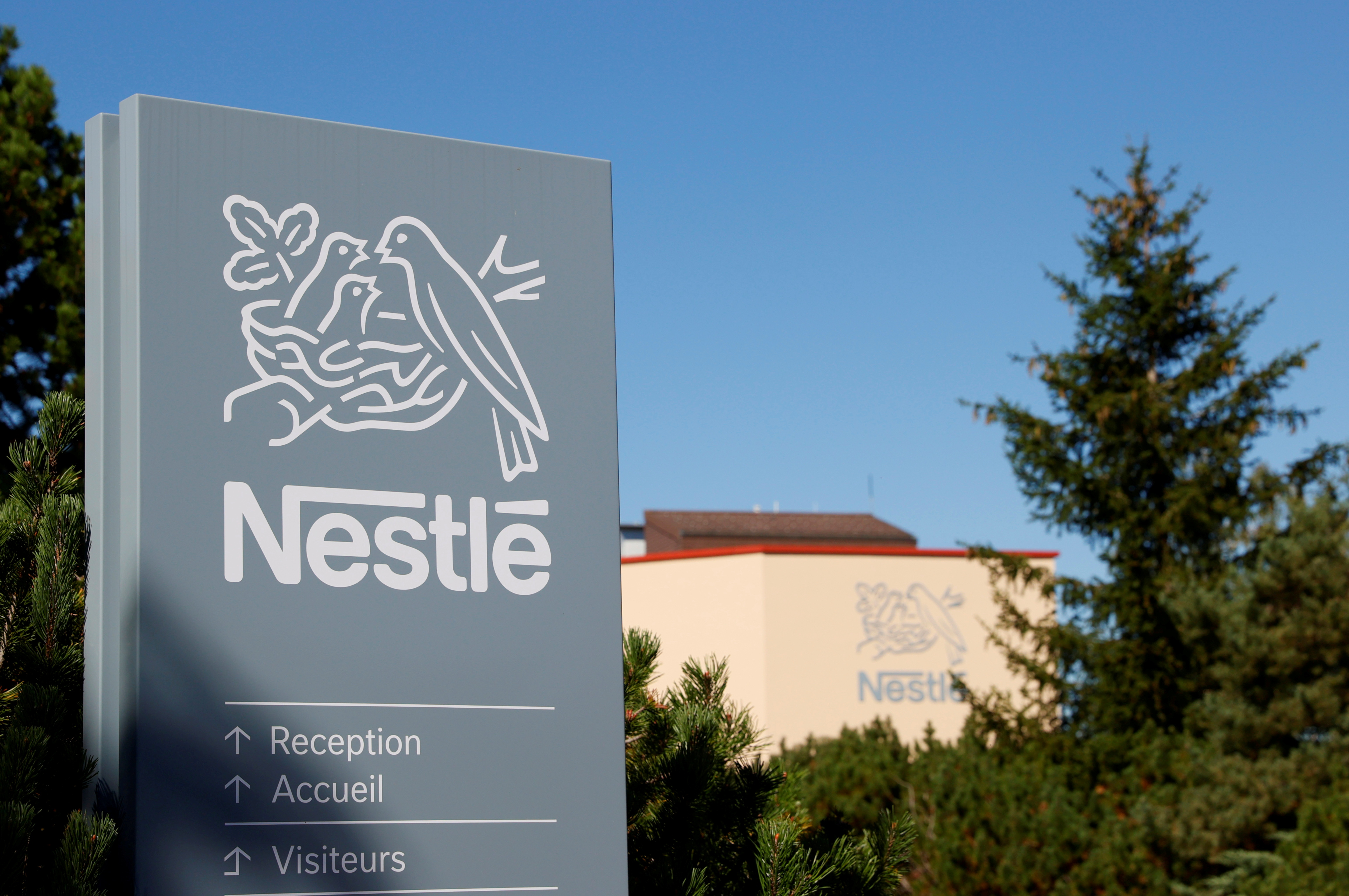 A logo is pictured on the Nestle research center at Vers-chez-les-Blanc in Lausanne, Switzerland August 20, 2020. REUTERS/Denis Balibouse/File Photo