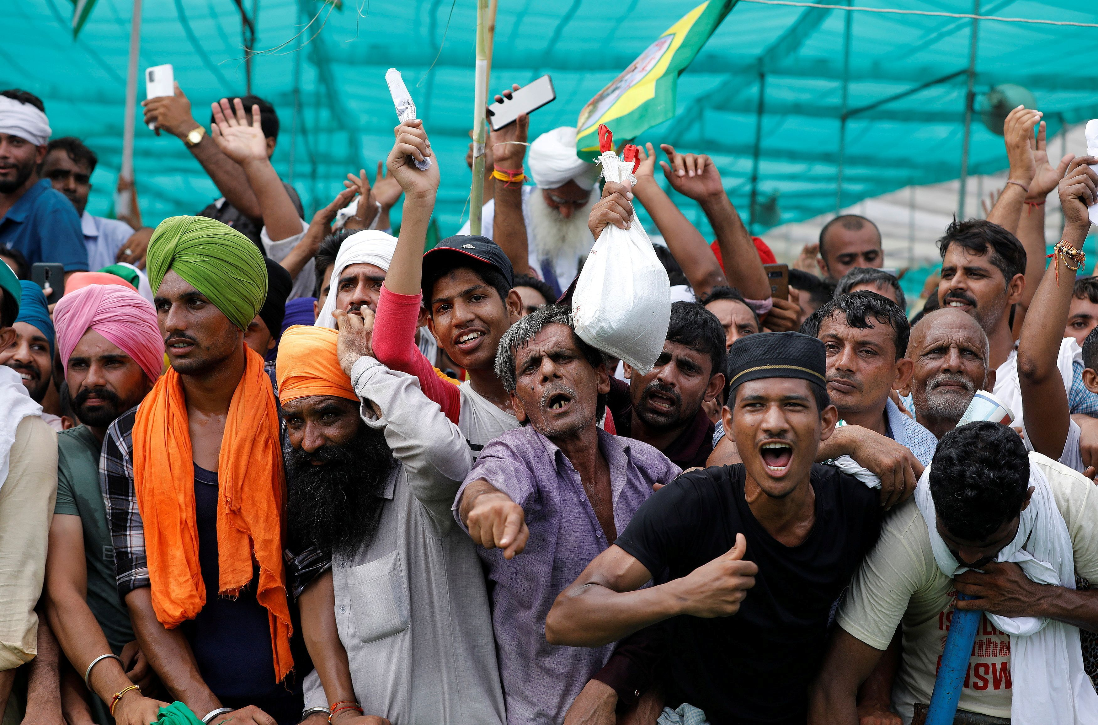 People shout slogans during a Maha Panchayat or grand village council meeting as part of a farmers' protest against farm laws in Muzaffarnagar in the northern state of Uttar Pradesh, India, September 5, 2021. REUTERS/Adnan Abidi
